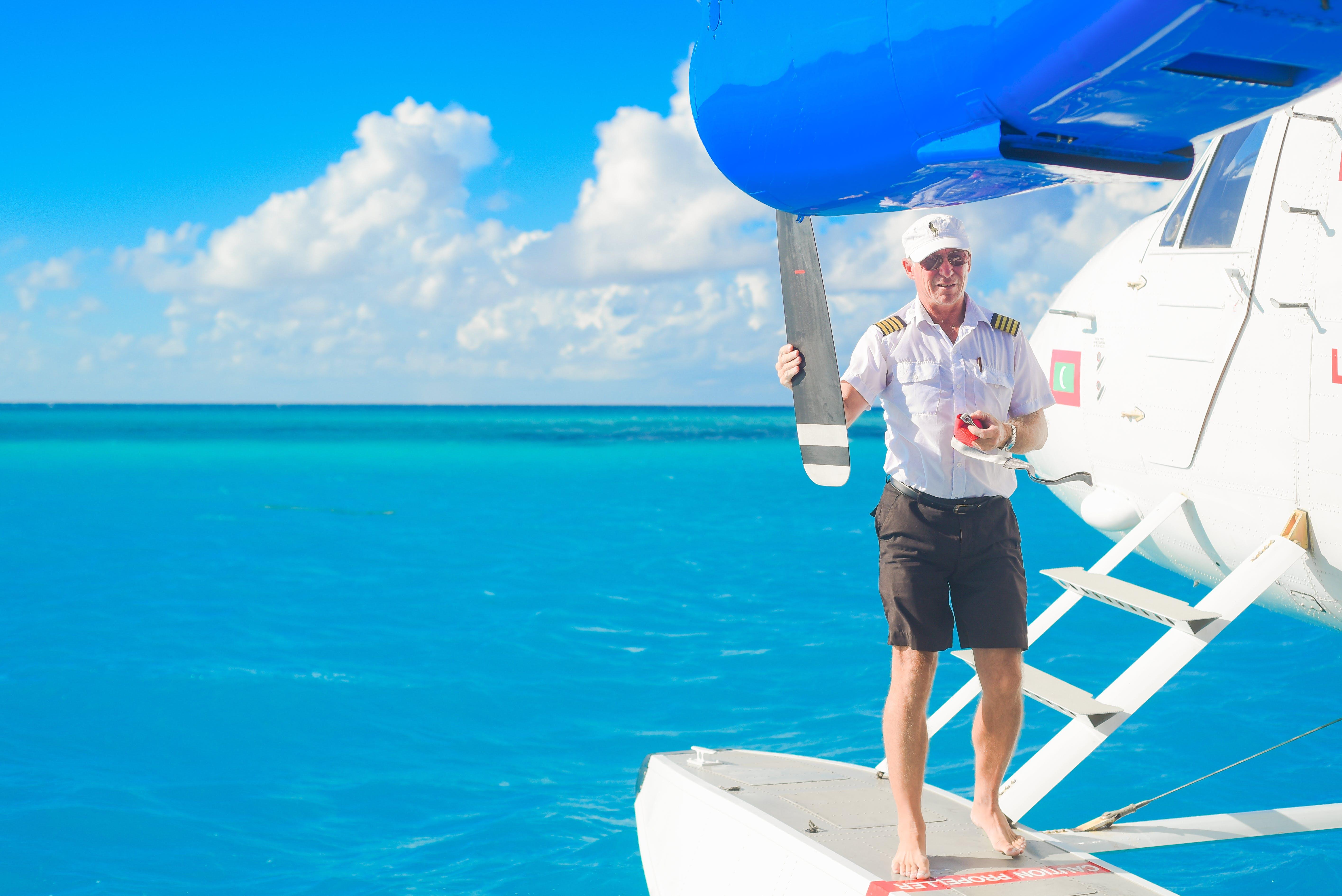 Man Standing on Seaplane Buoyancy