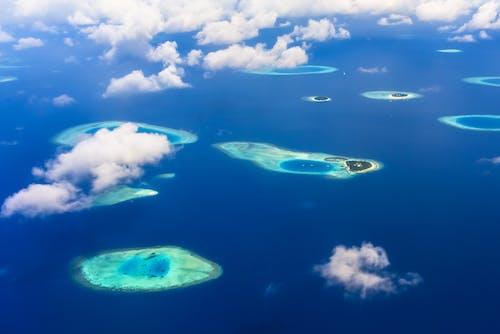 Darmowe zdjęcie z galerii z archipelag, chmury, dzień, horyzont