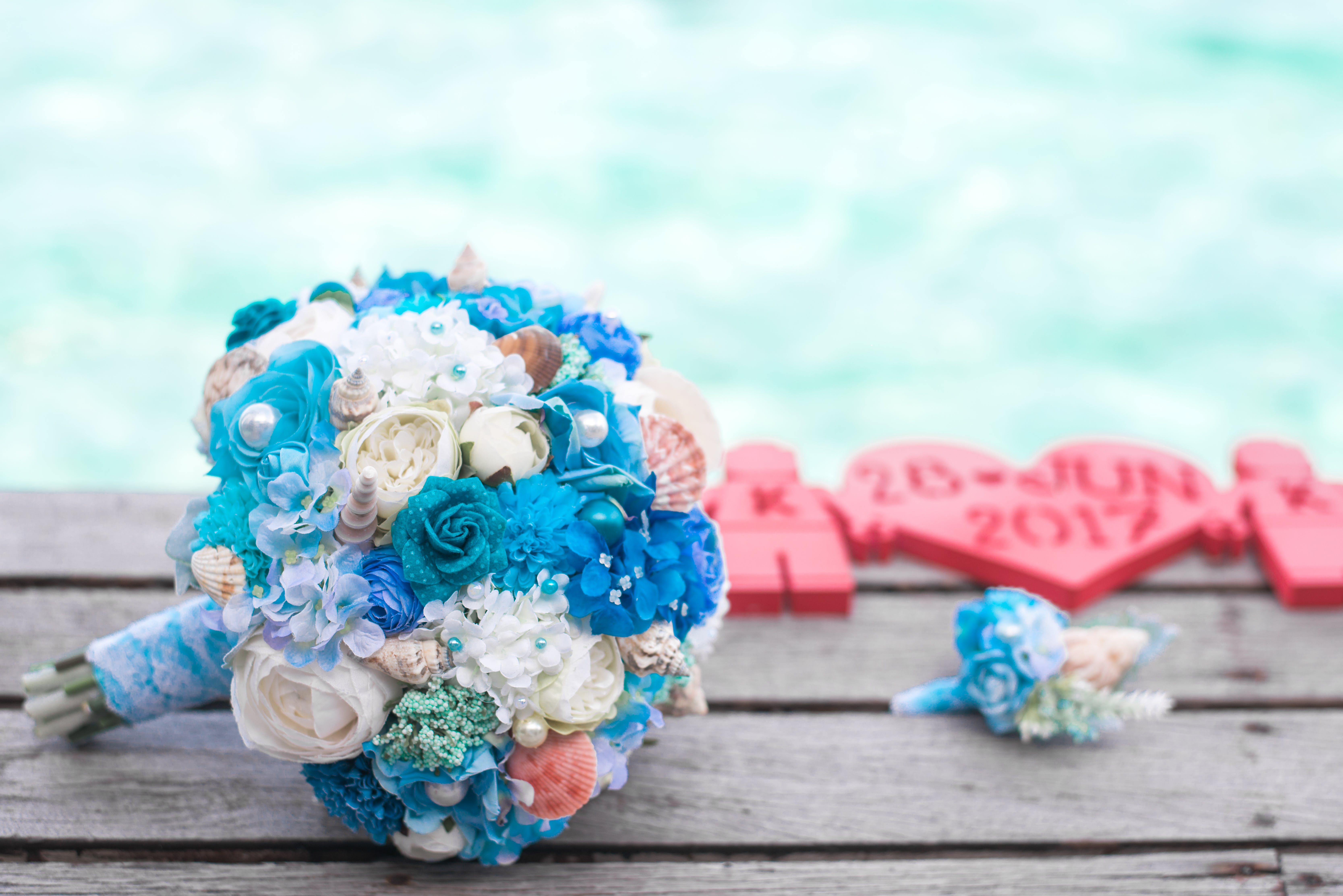Bouquet of Blue and White Flowers on Top of Brown Surface
