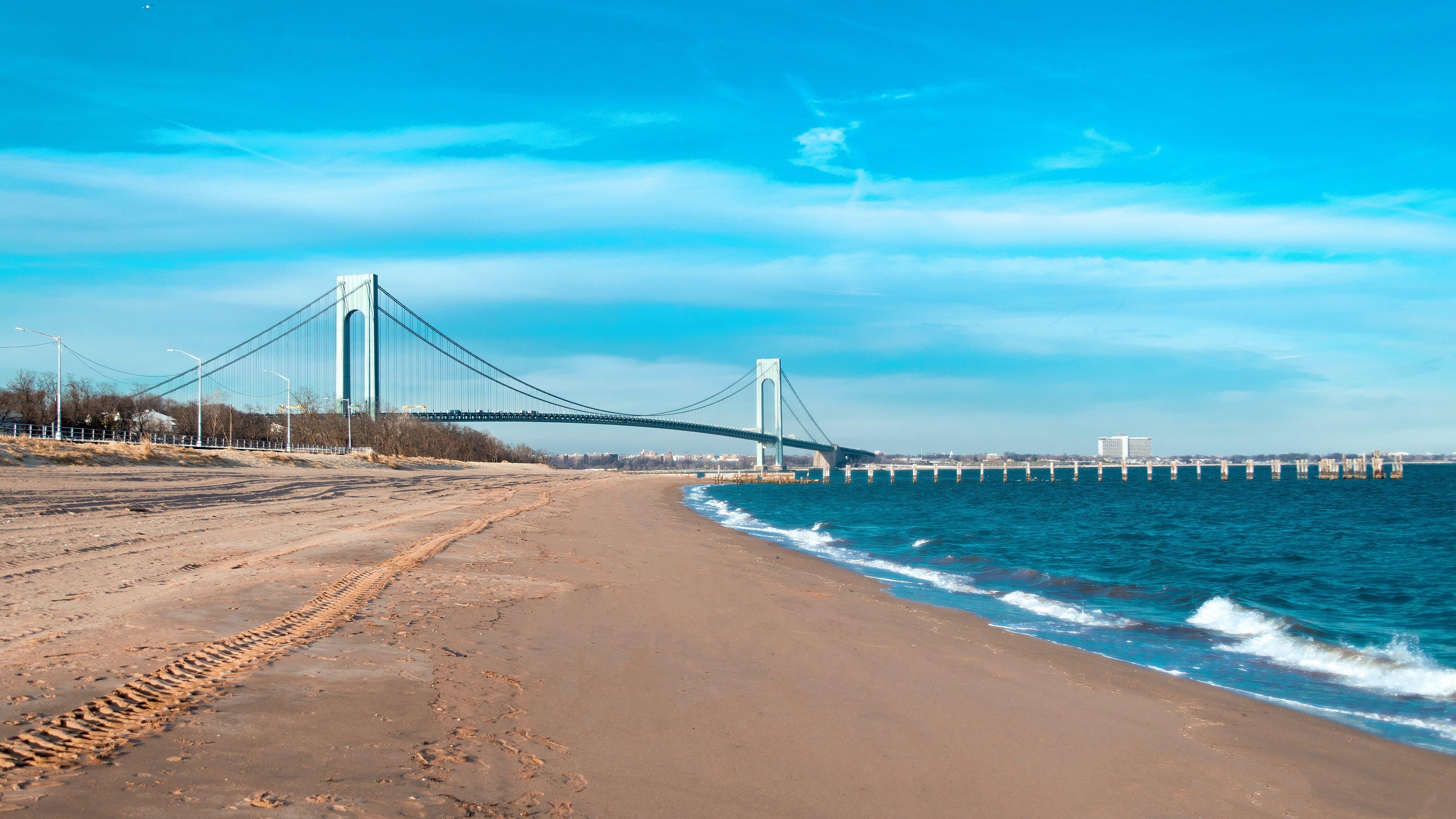 Free stock photo of 4k wallpaper, beach, blue skies, bridge