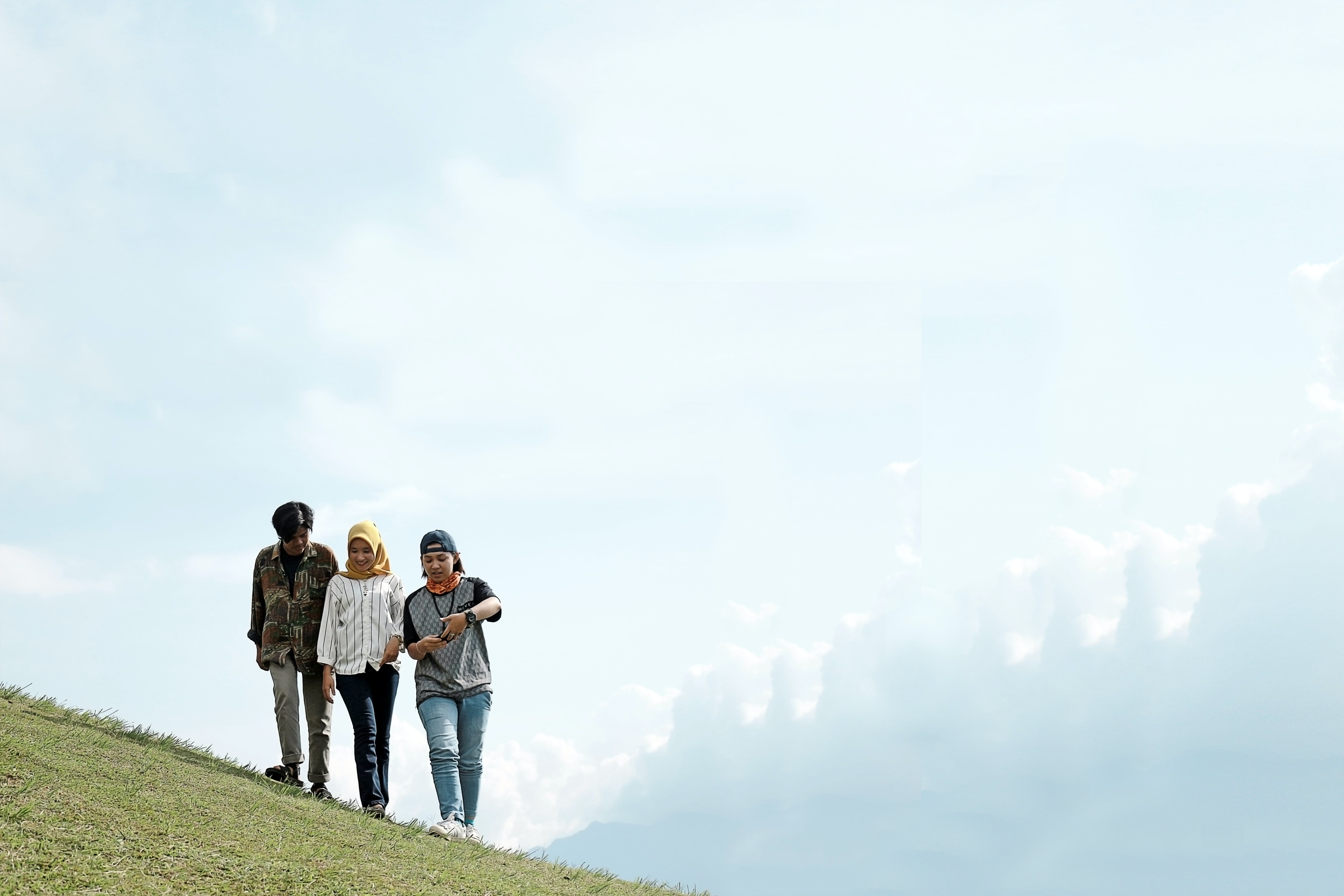 Photo of People Walking on Hillside