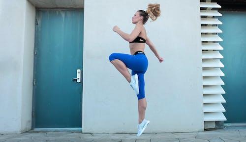 Photo of Woman Jumping Near Doorway