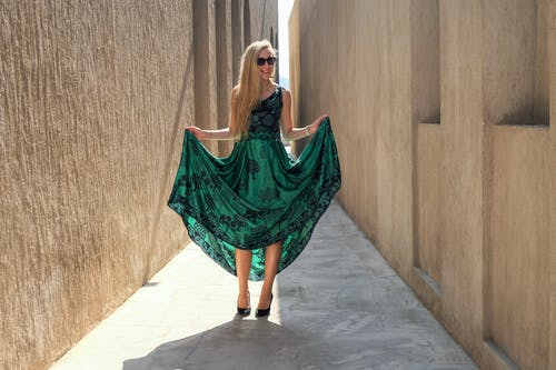 Photo of Woman Holding Her Green Dress