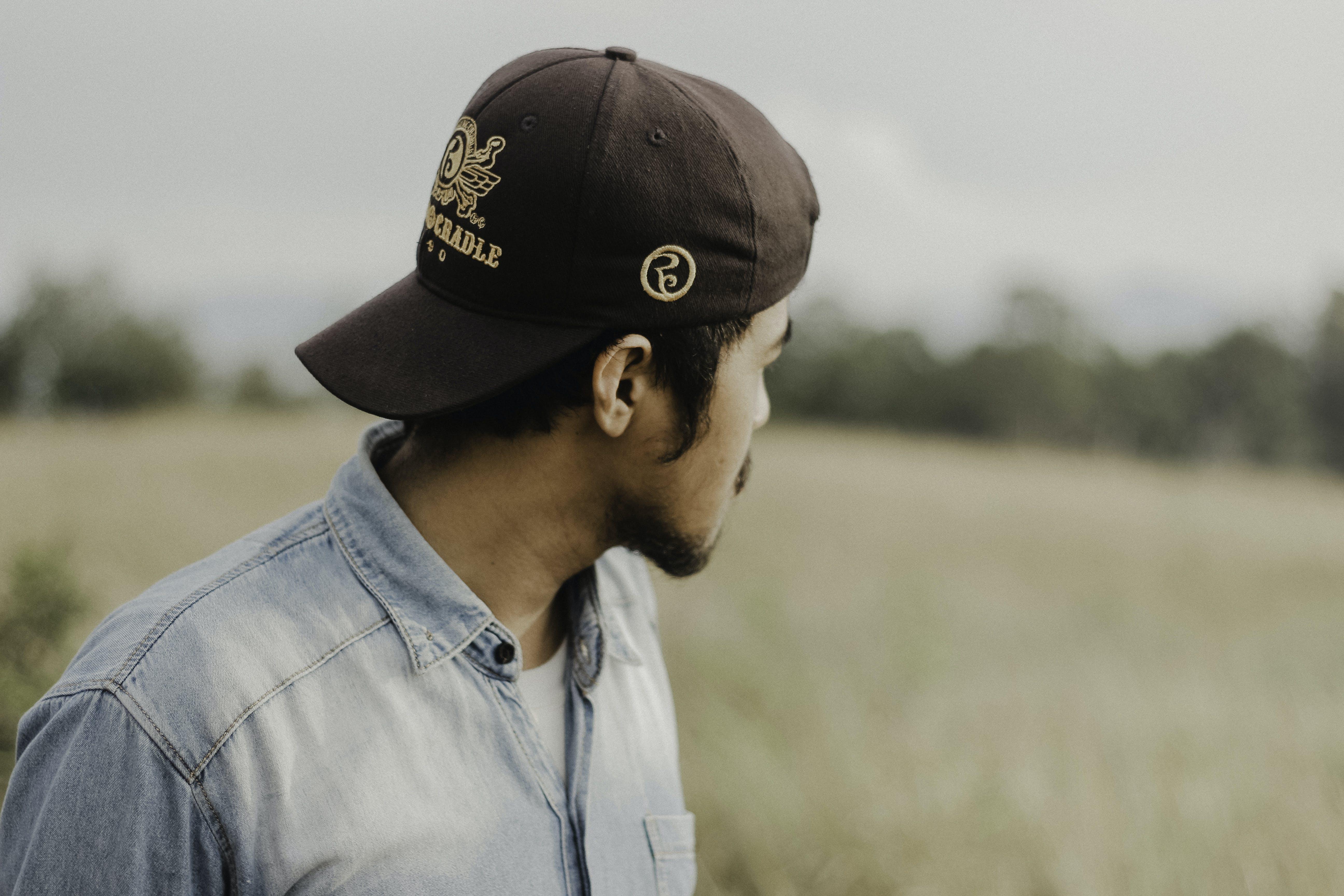 Selective Focus of Man Wearing Brown Cap