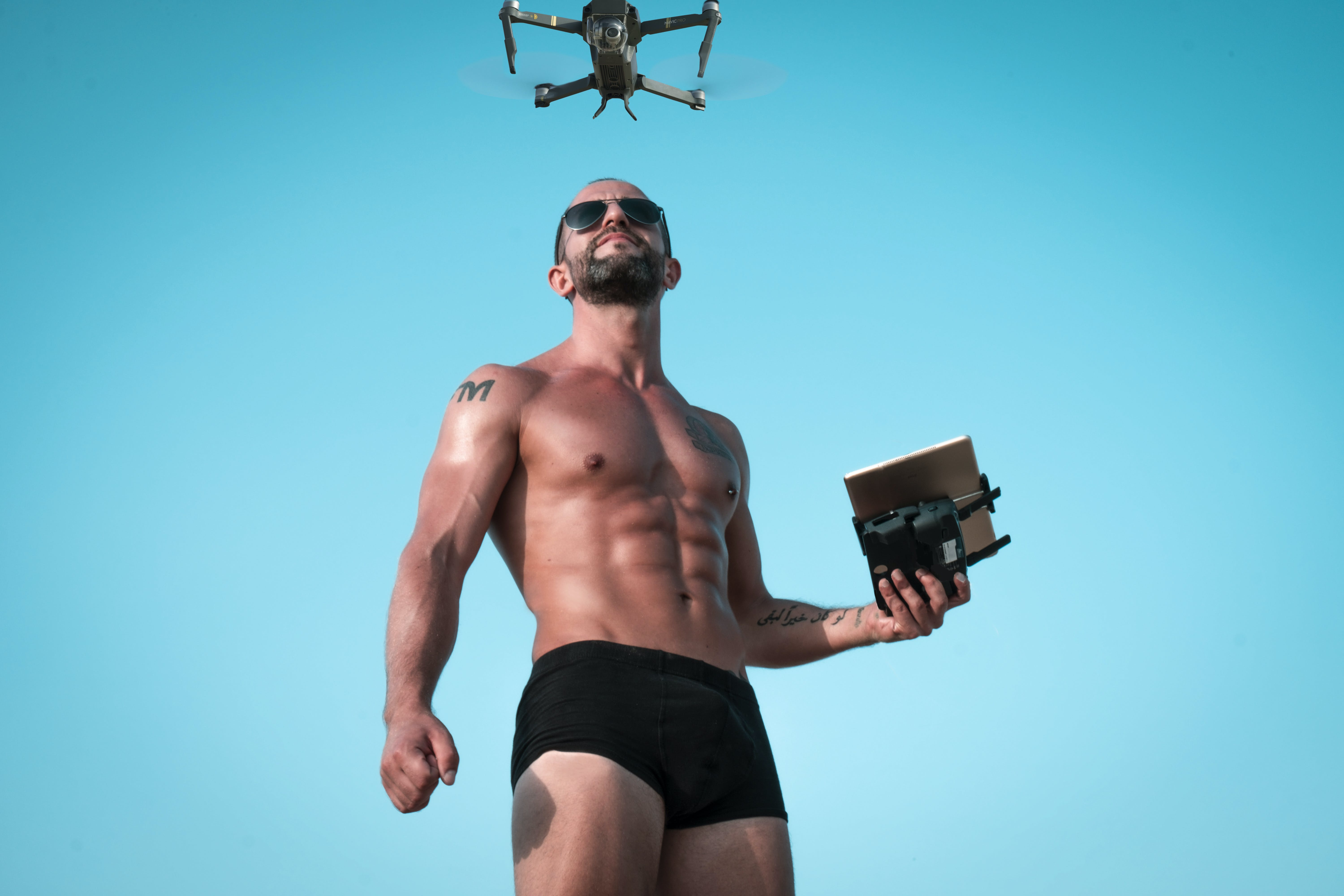 Photo of Man Controlling Black Drone