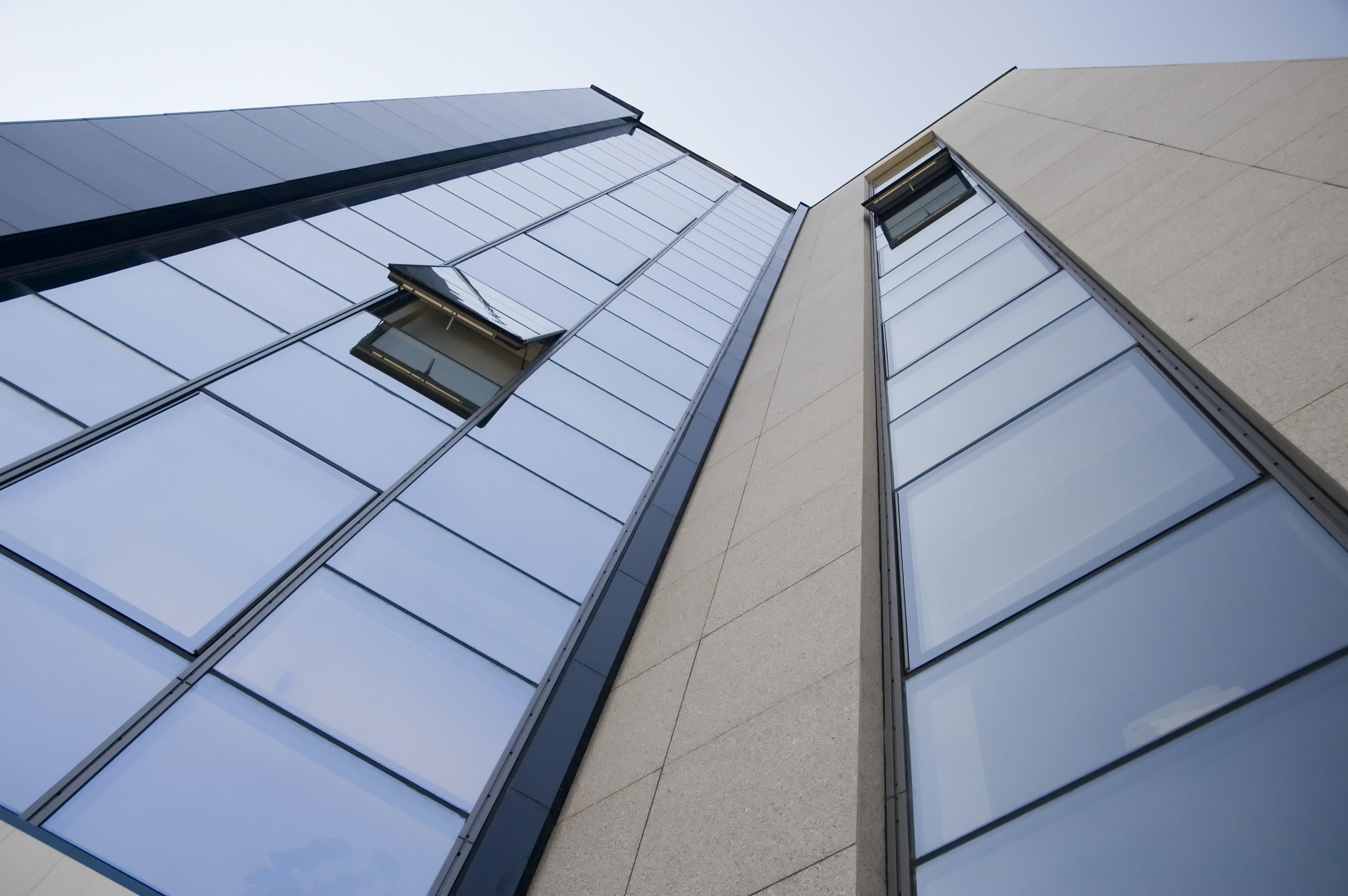 Gray Concrete Building With Glass Windows in Low-angle Photography