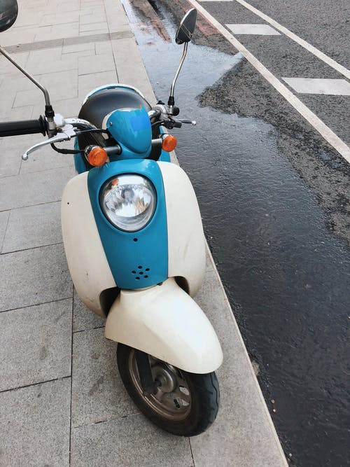 Photo of Motor Scooter Parked On Pavement