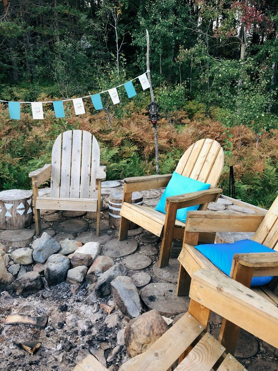 Wooden Armchairs In Front of a Campfire