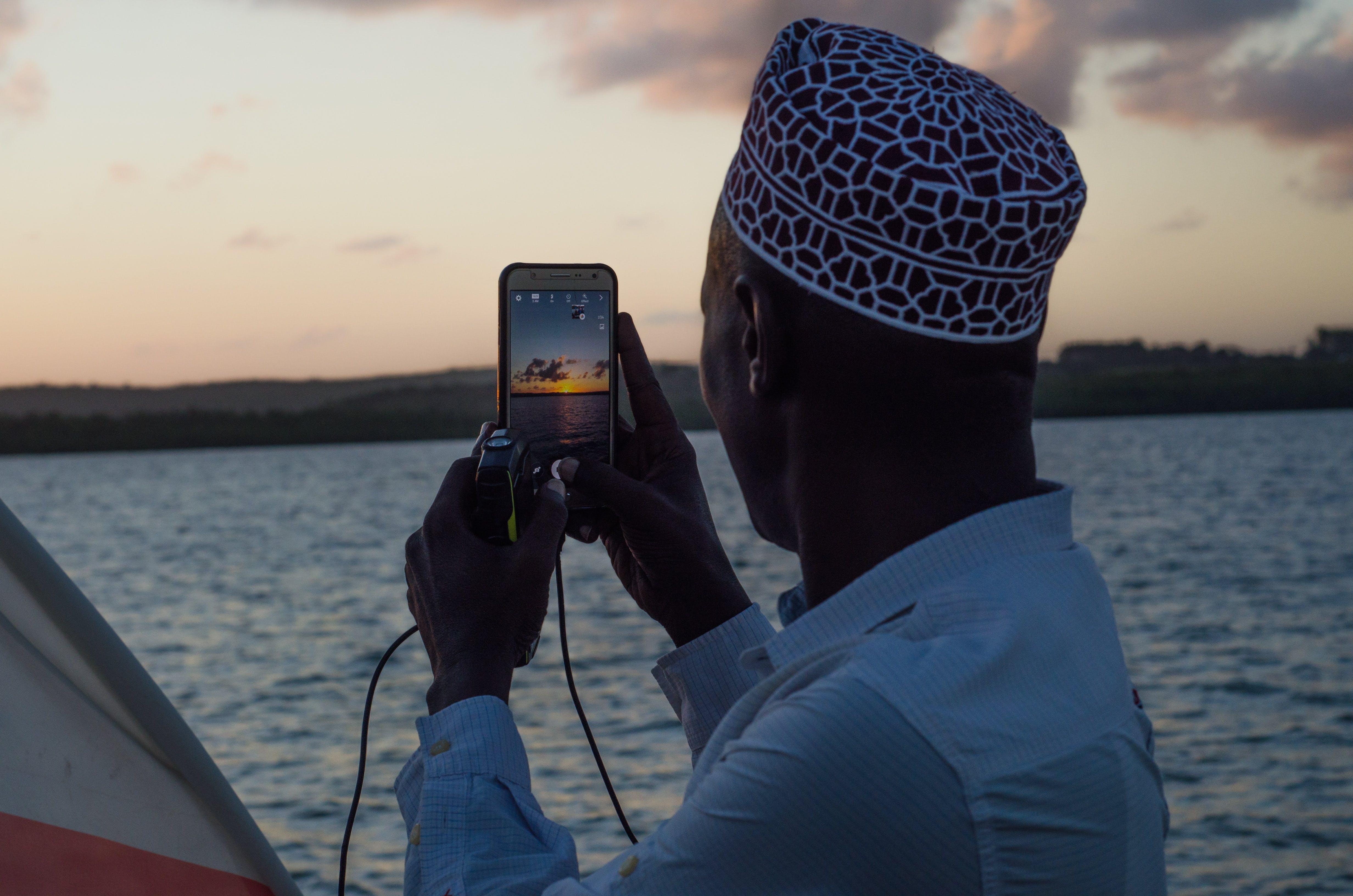 Free stock photo of african man, golden sunset, muslim, ocean