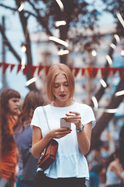 Close-Up Photo of Woman Using Phone