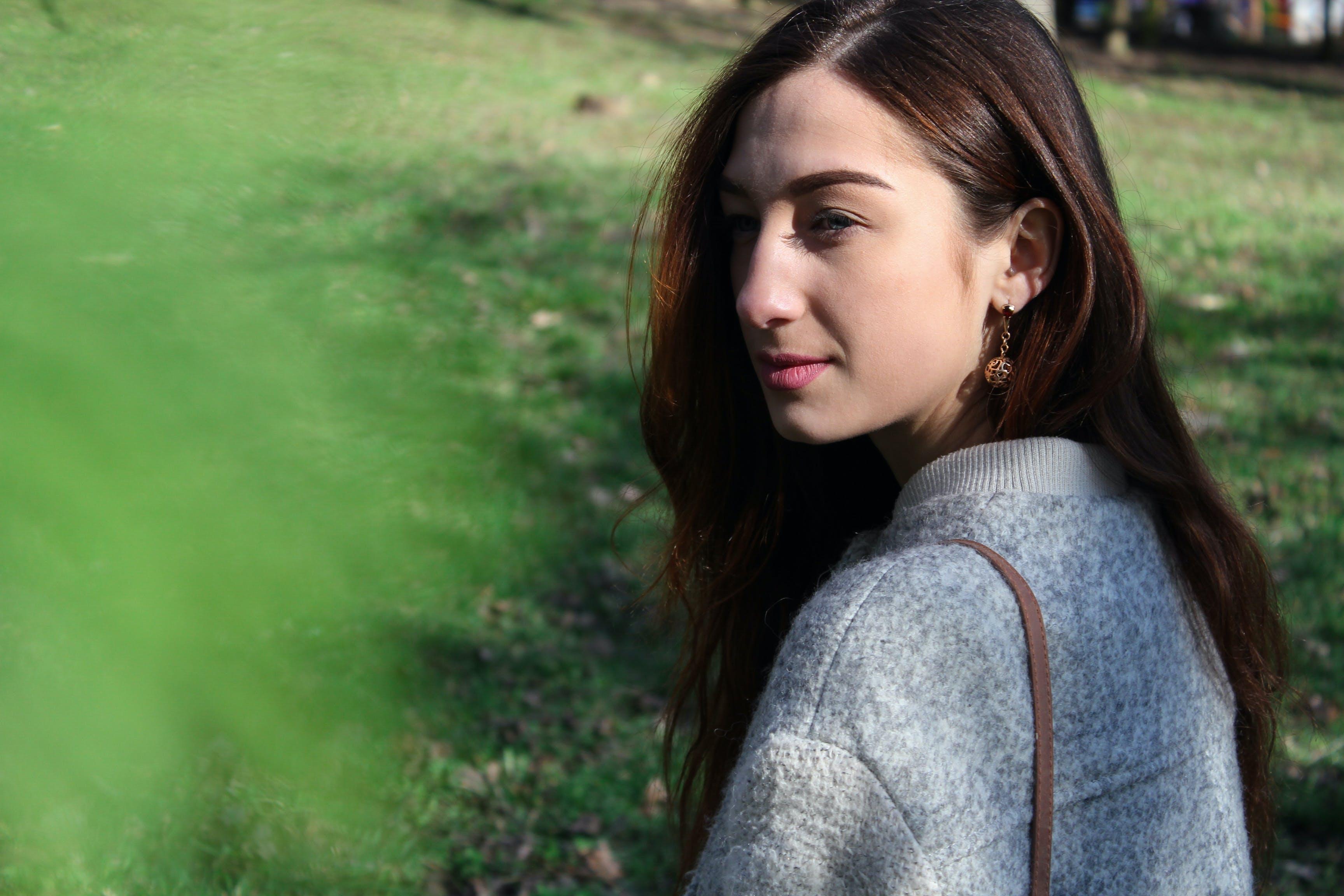 Woman in Gray Sweater Beside Grass Field