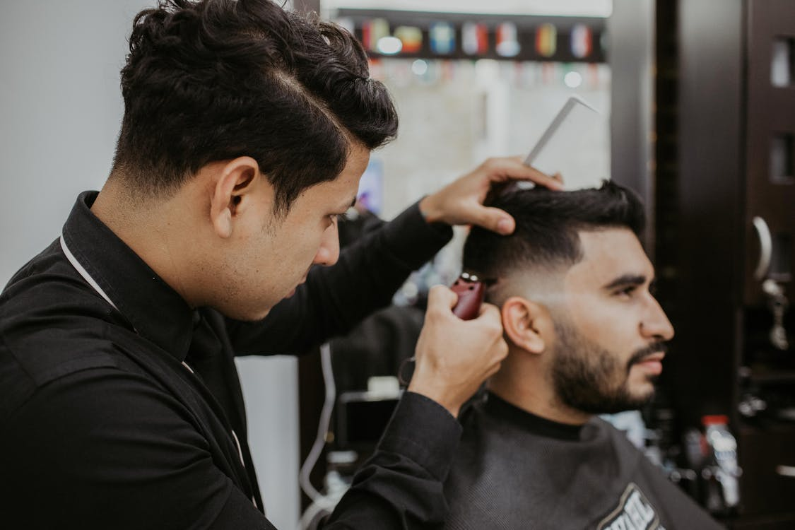 Man Trimming Another Man's Hair