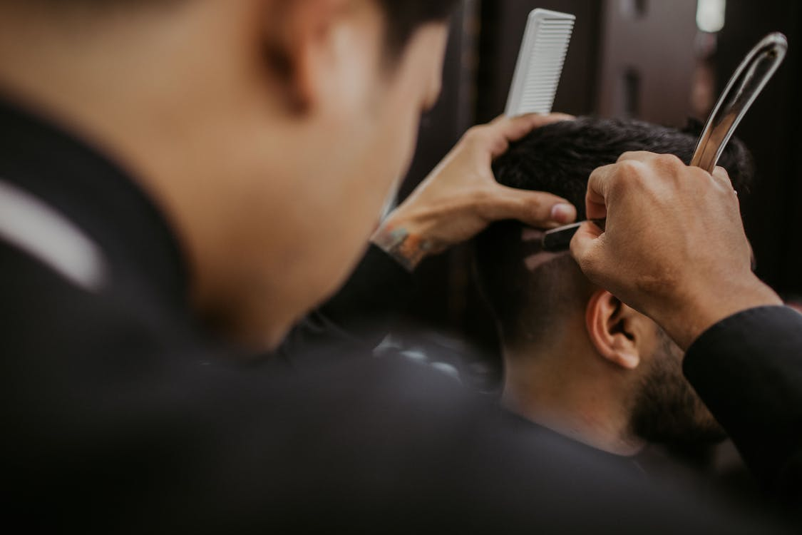Selective Focus Photography of a Barber