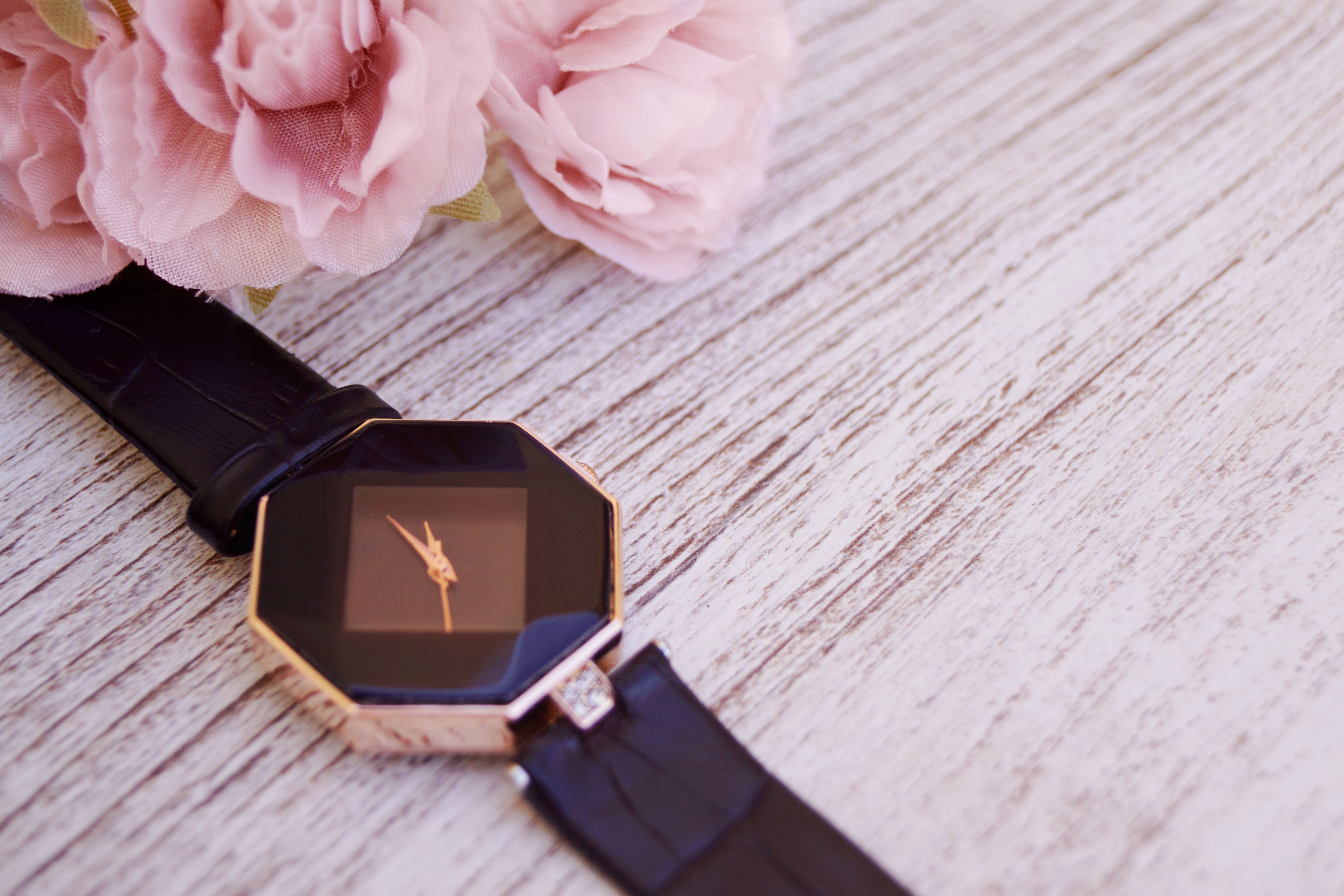 Gold-colored Analog Watch on Beige Wood Surface