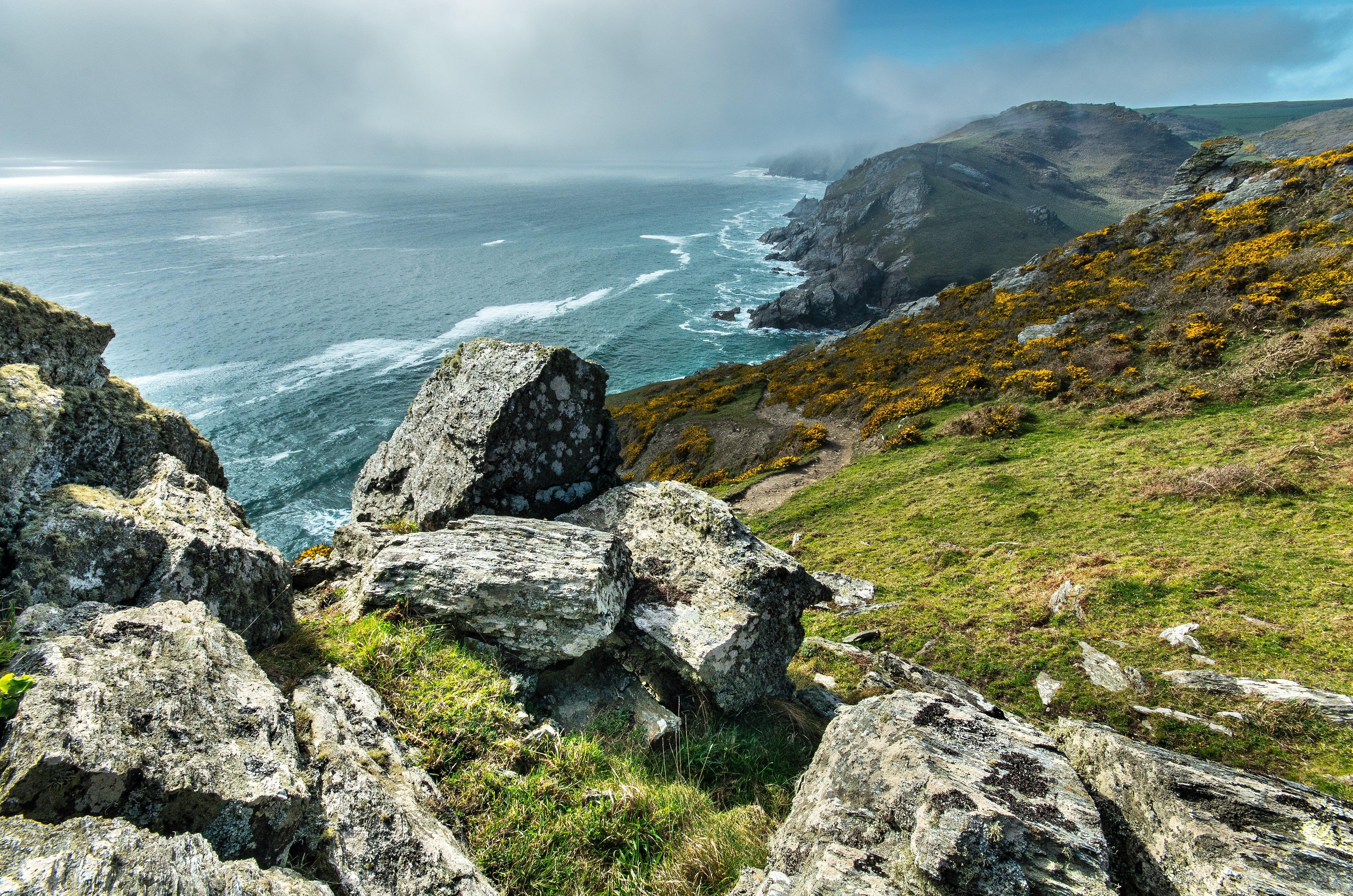 Landscape Photography of Mountain Beside Beach Shoreline