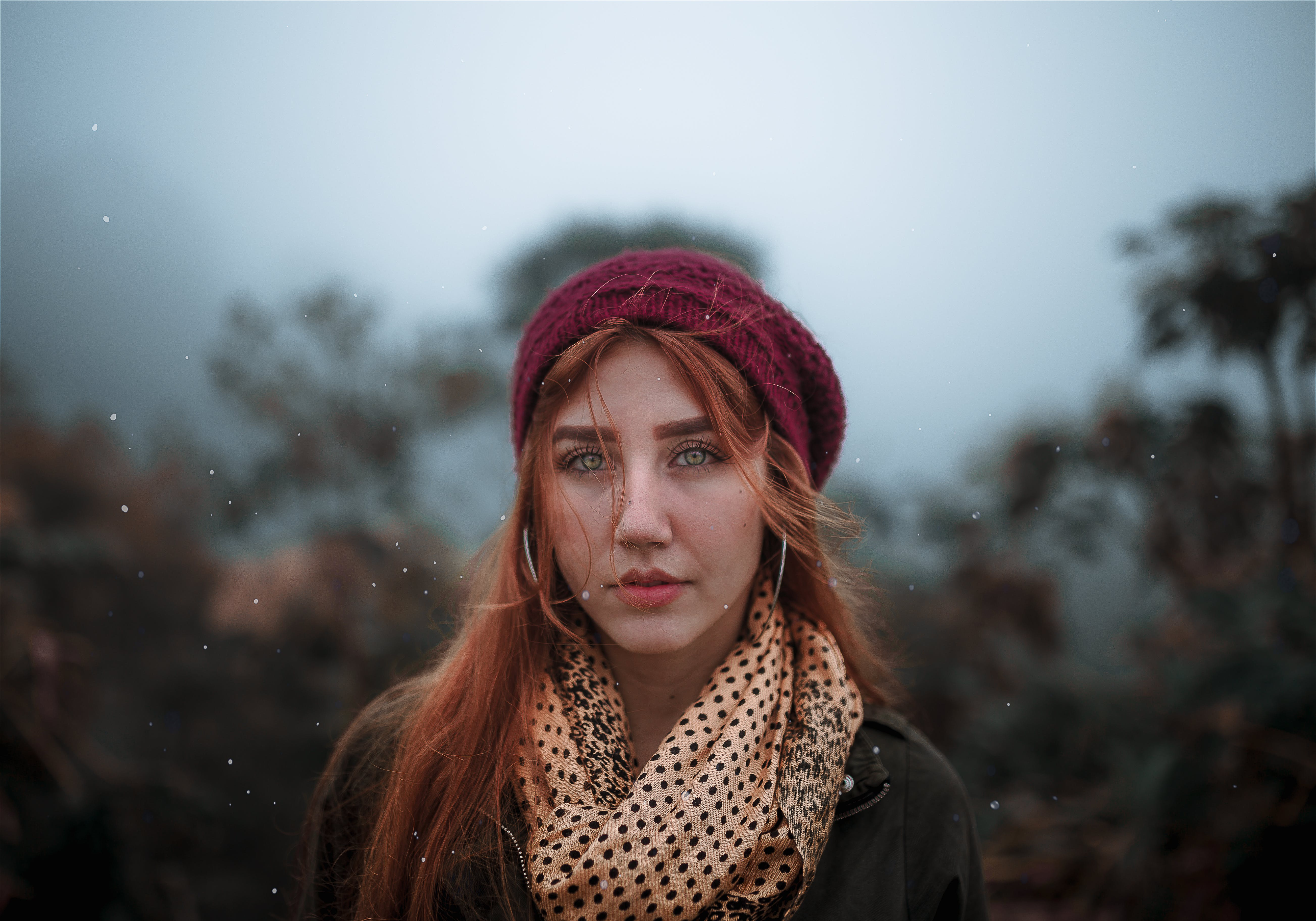 Selective Focus Photo of Woman Wearing Red Beanie