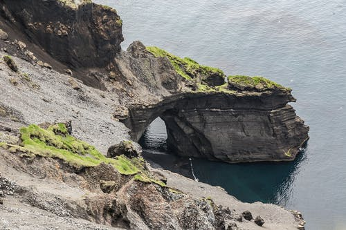 Gray Promontory Near Body of Water