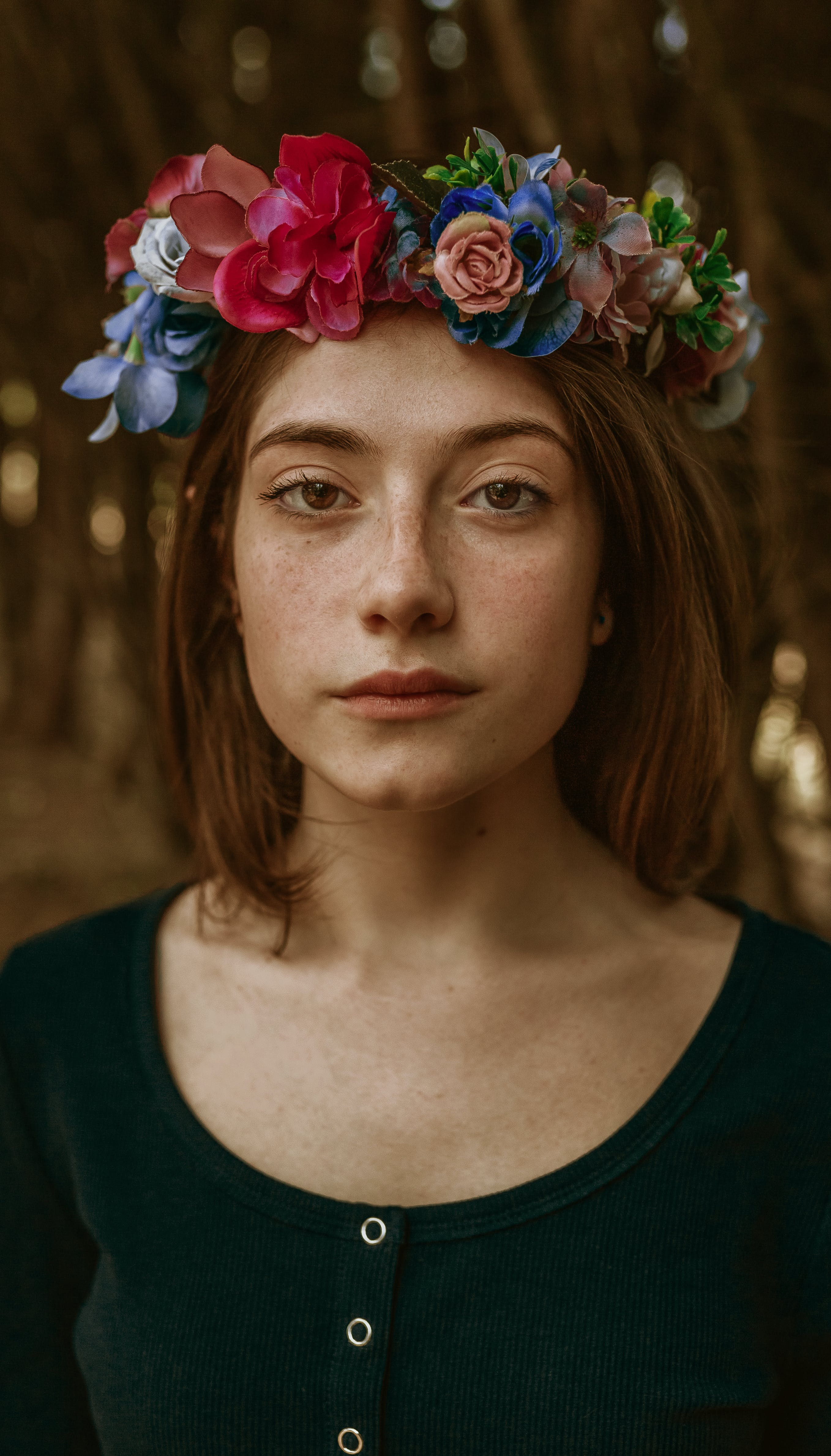 Close-up Photo of Woman Wearing Floral Headdress