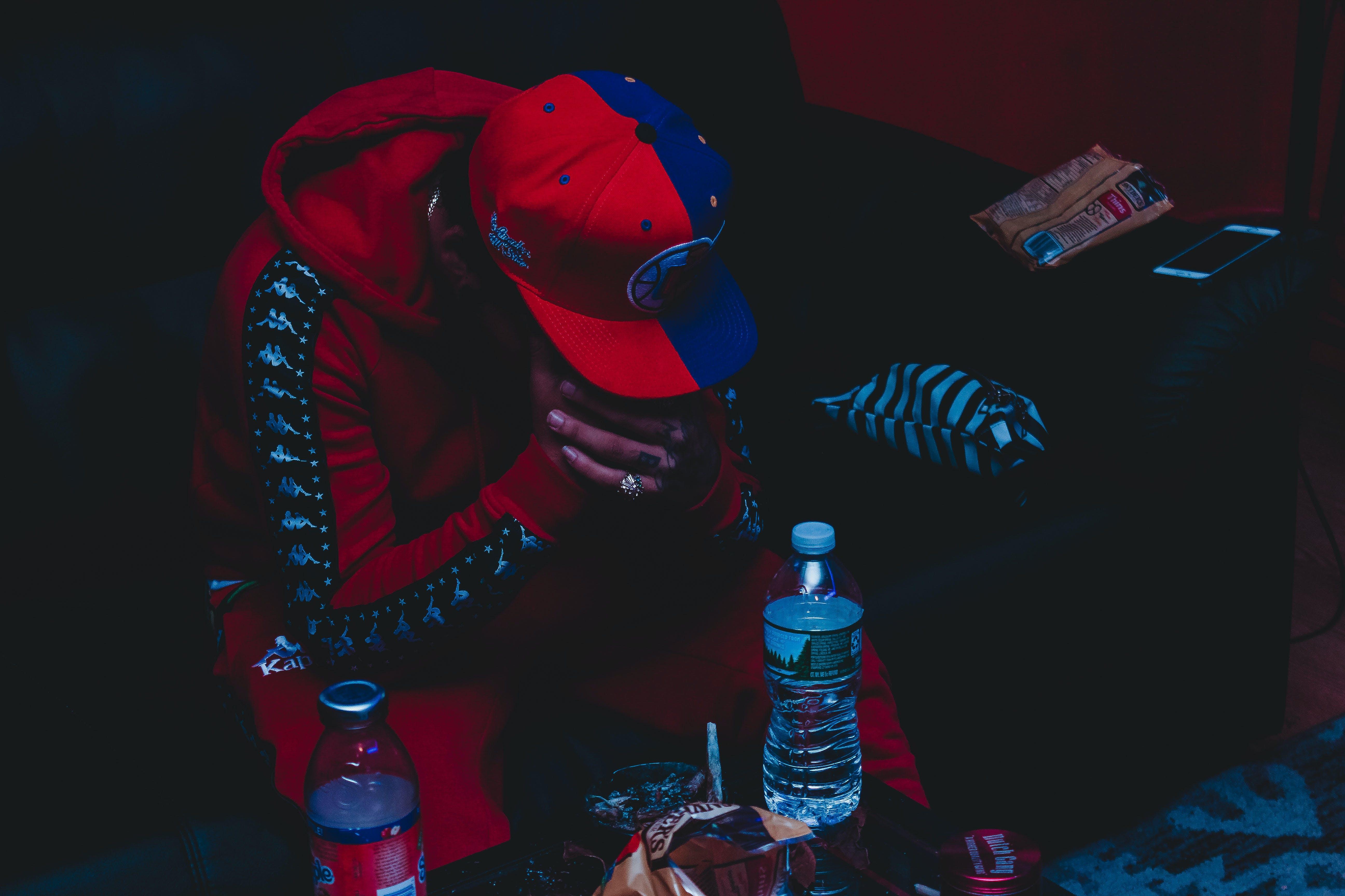 Person Sitting Near Plastic Bottle