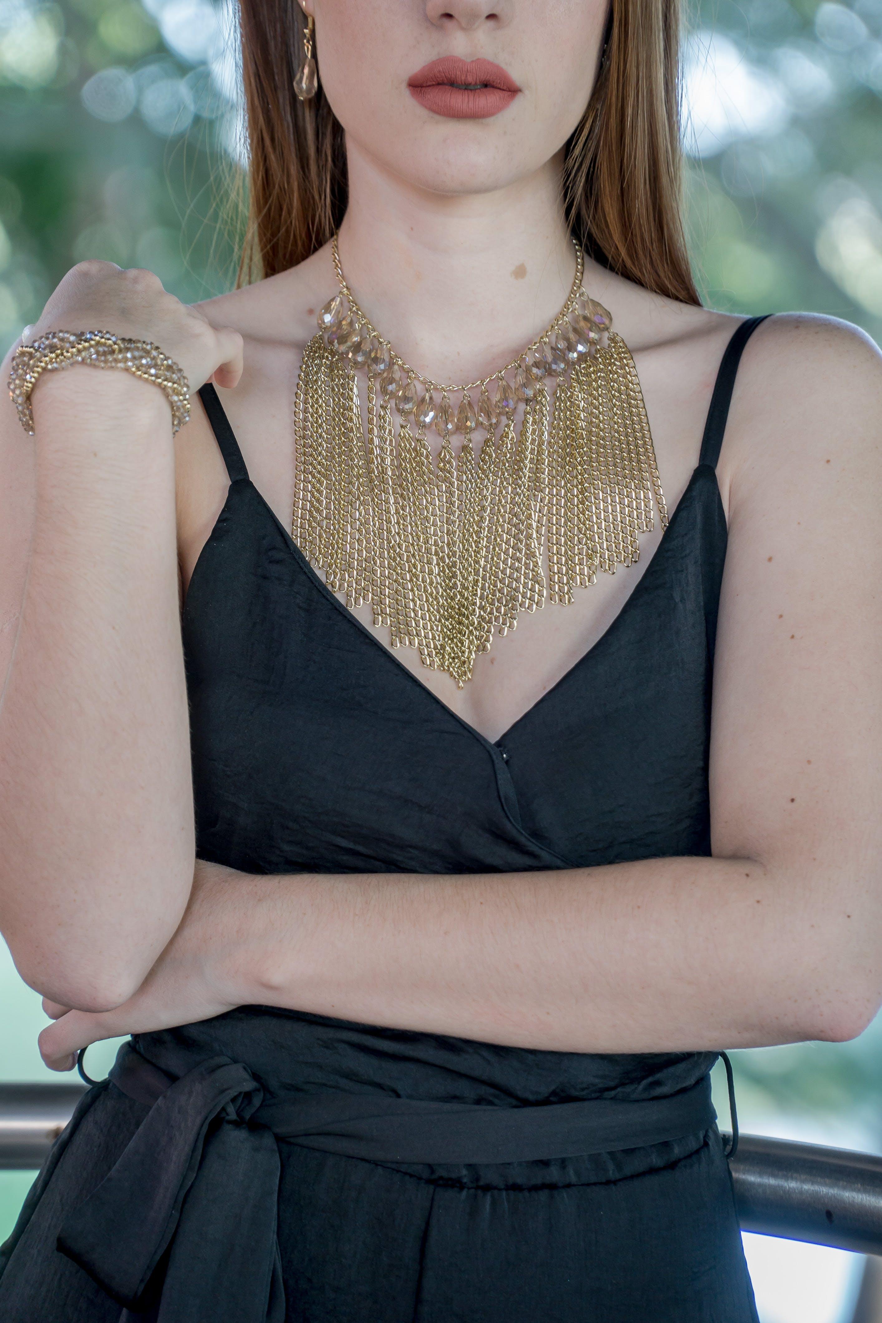 Woman Wearing Gold Chain Bib Necklace