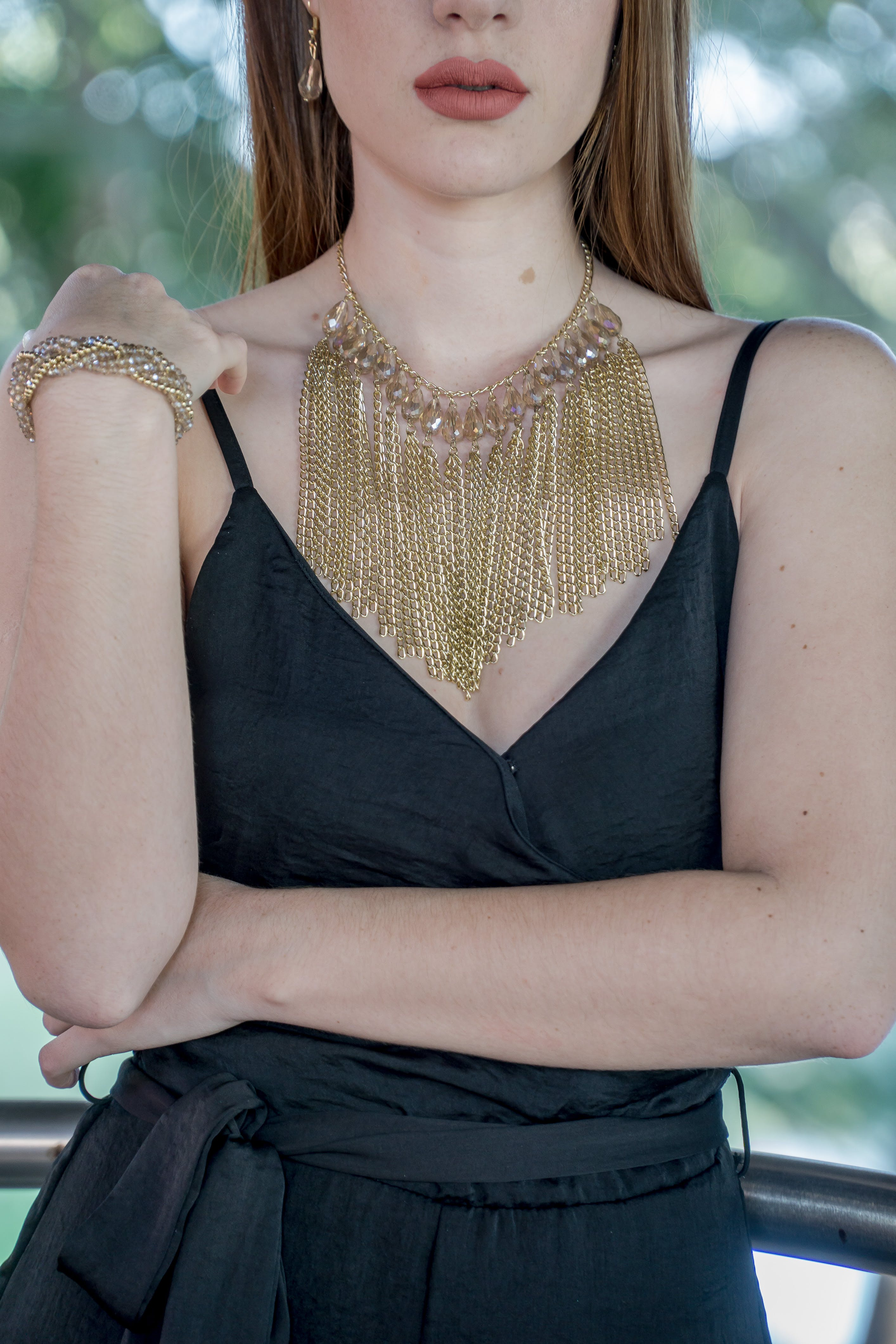 Woman Wearing Gold Chain Bib Necklace
