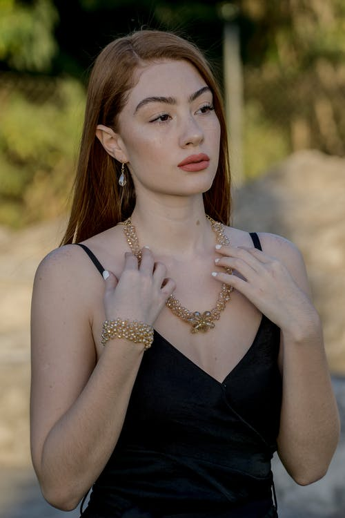 Woman Wearing Black Camisole And Gold Necklace
