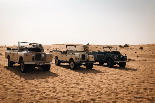 Three Off-road Cars At The Dessert