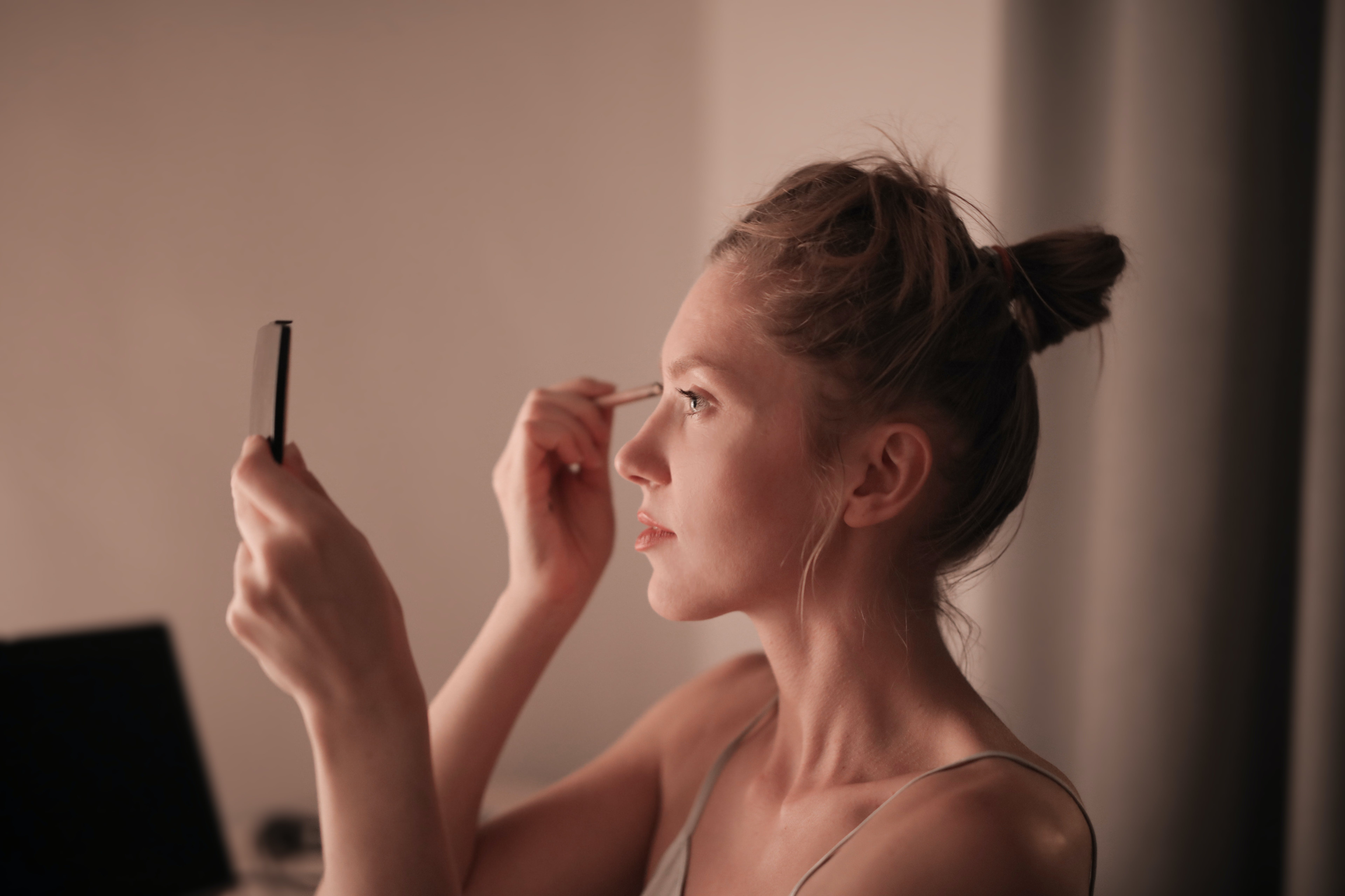 Woman Putting Makeup on Face
