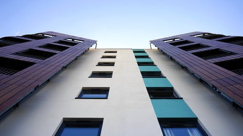 Low Angle Photography of White and Purple Concrete Building