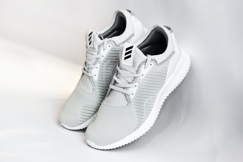 Sneakers with dense surface against gray background
