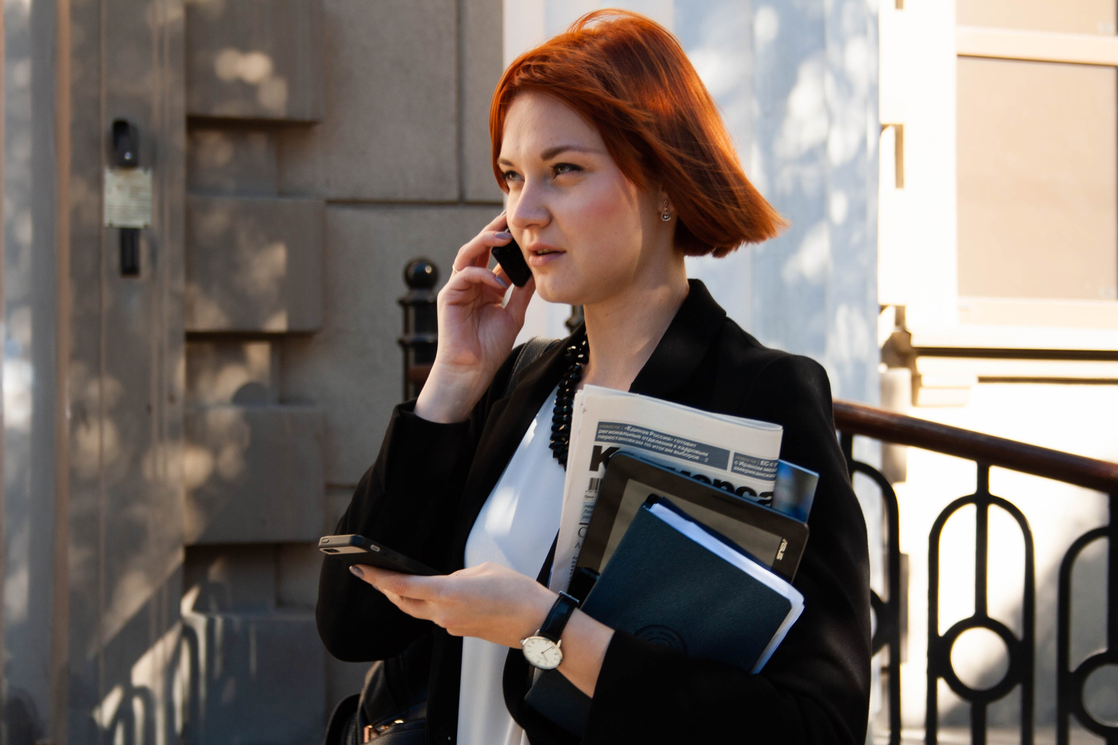 Woman Talking to Her Phone