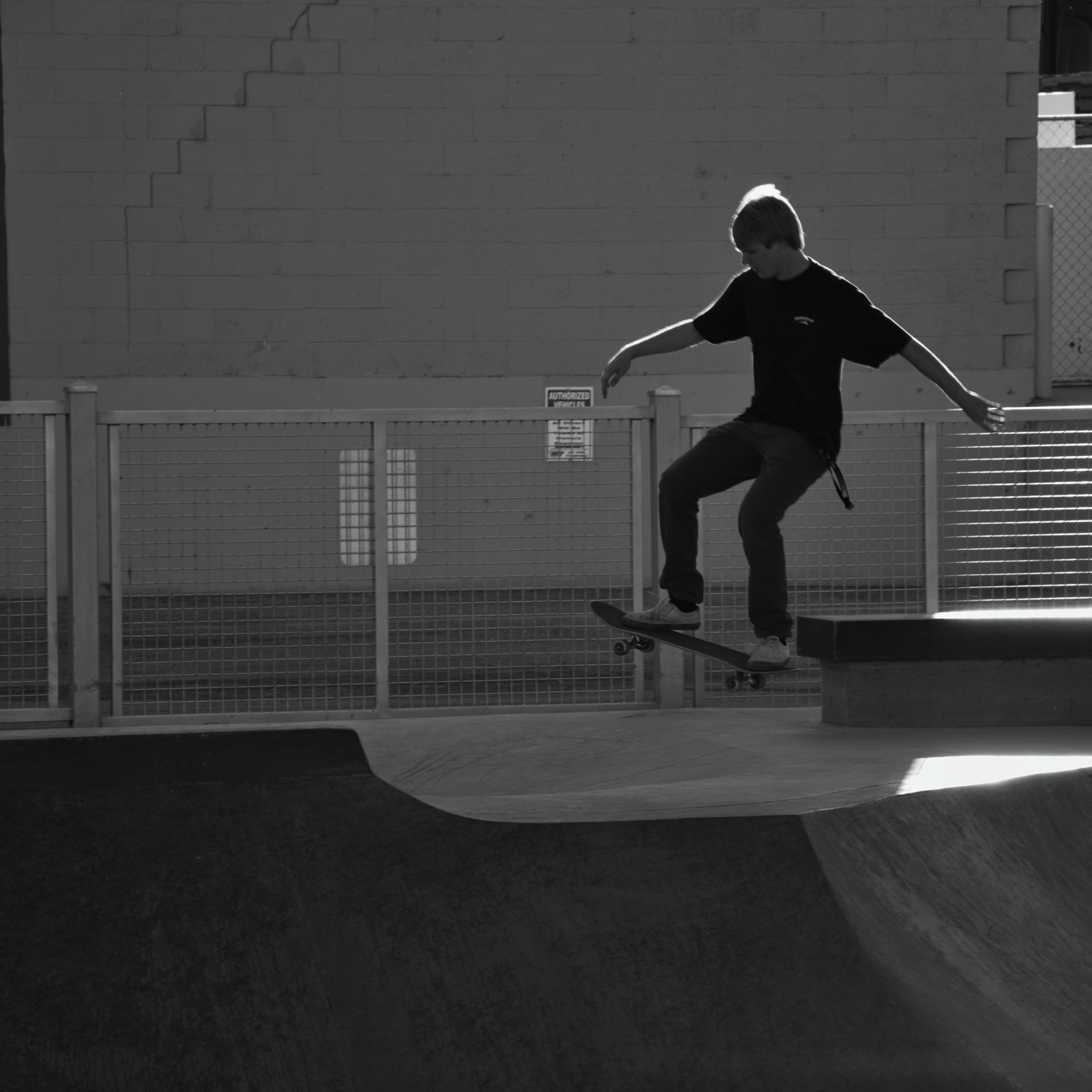 Person Skateboarding in Grayscale Photography