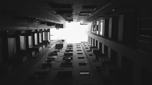 Grayscale and Worm's Eye View Photography of Building