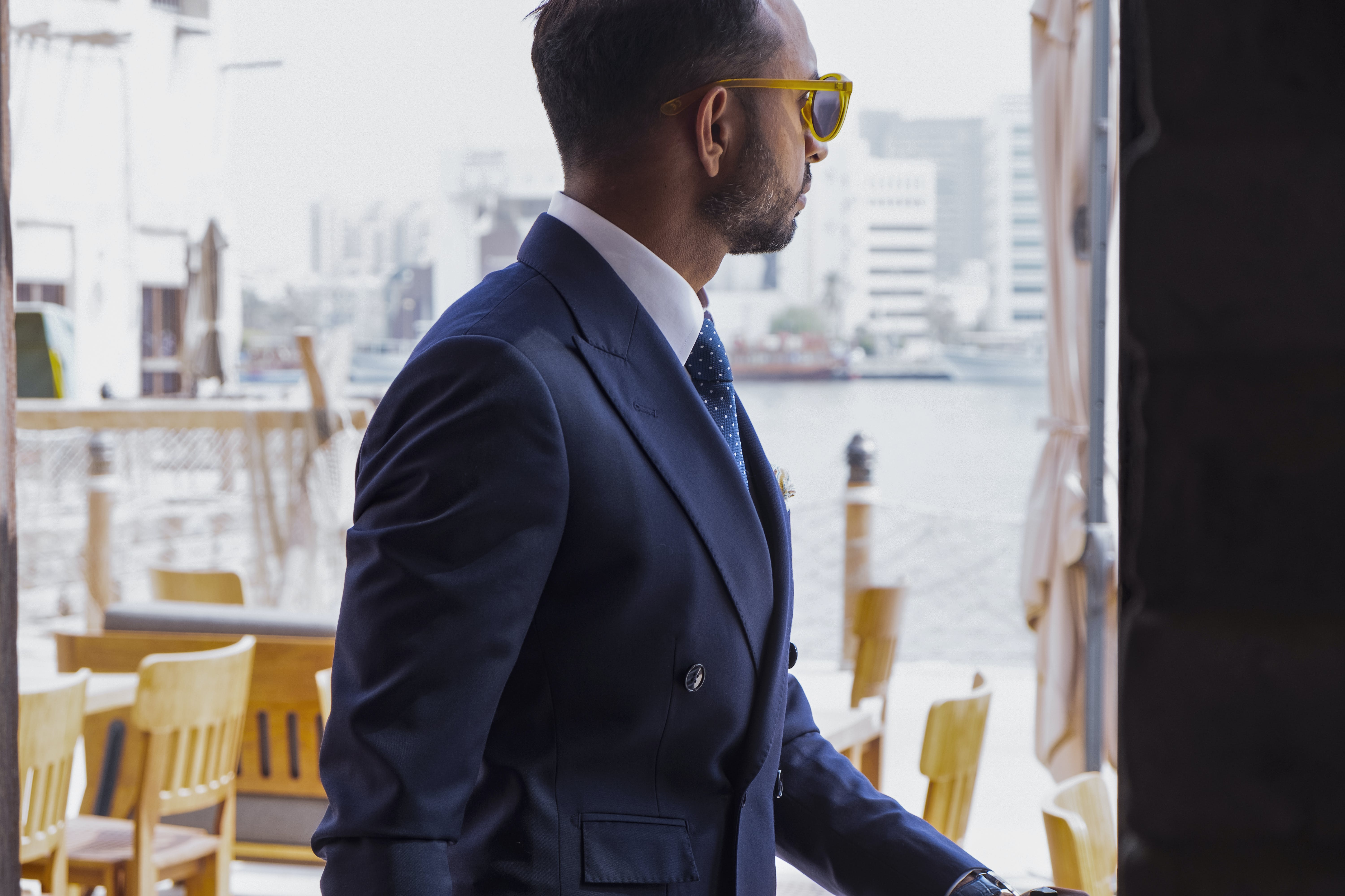 Photo of Man Wears Black Shawl-lapel Blazer and Yellow Rimmed Sunglasses