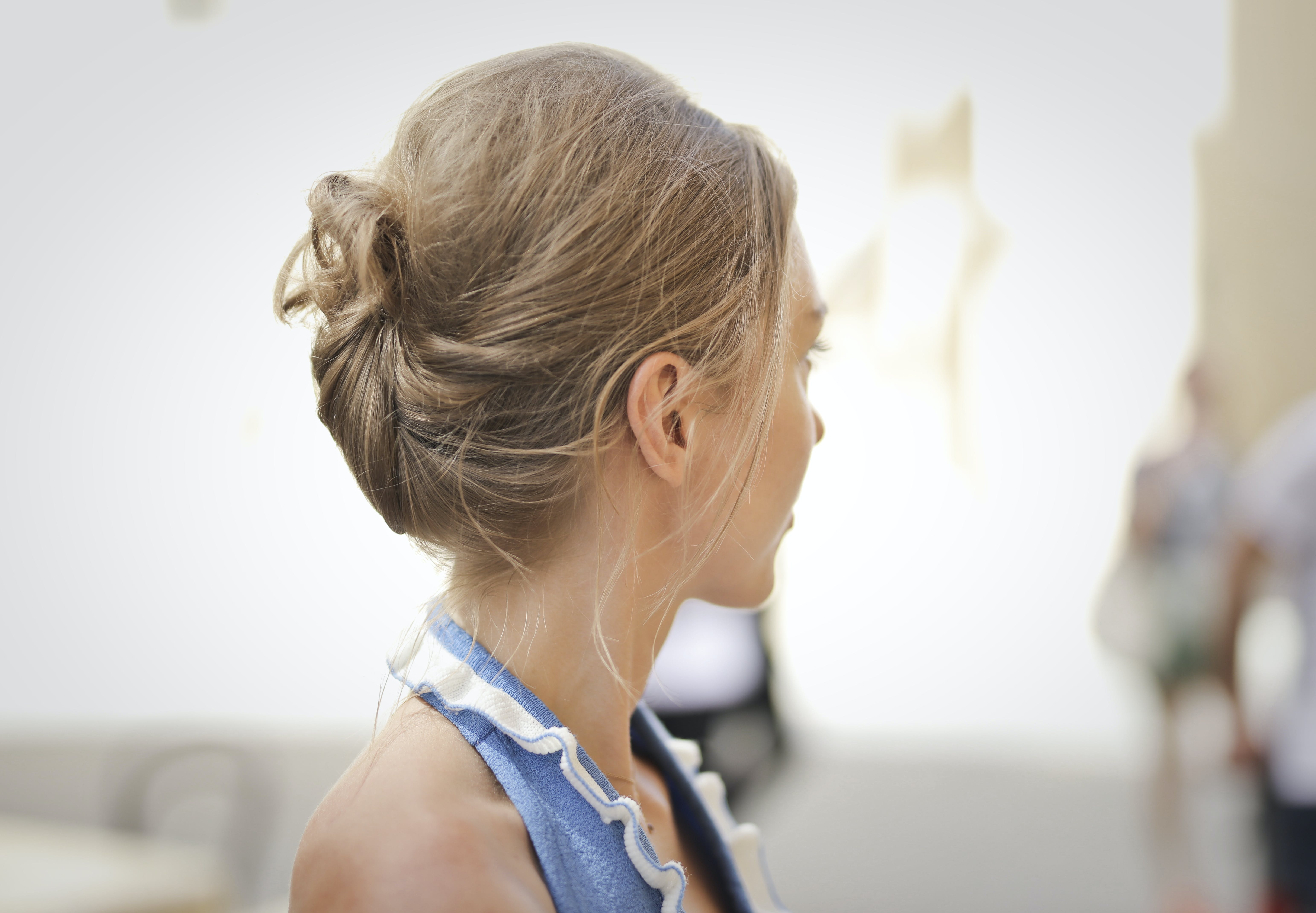 Selective Focus Photography of Woman Looking on Side