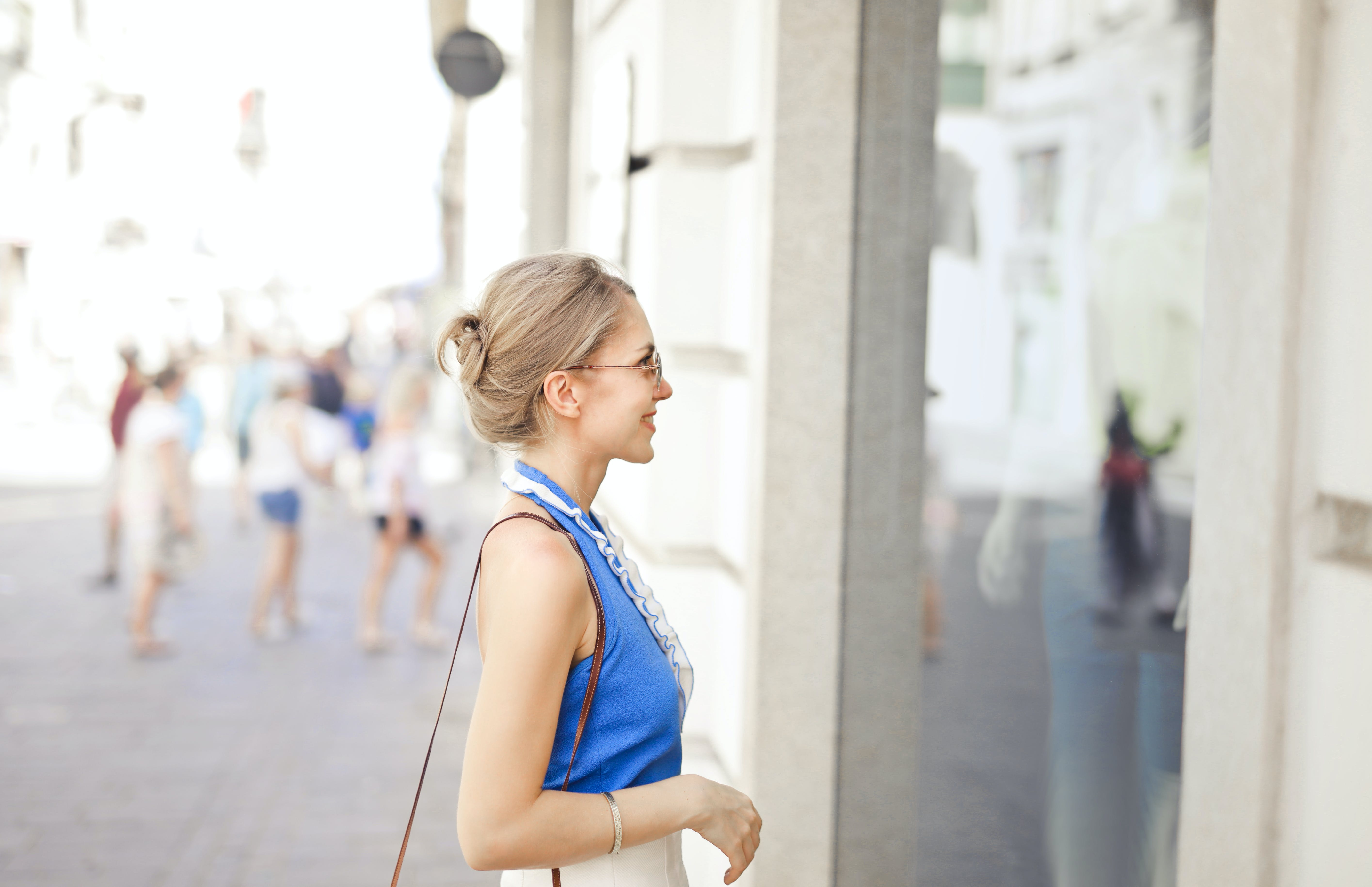 Woman Standing in Front of the Store