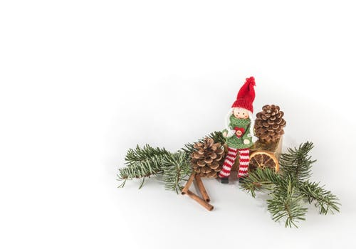 doll sitting between pine cone illustration - Christmas Decoration Images Free