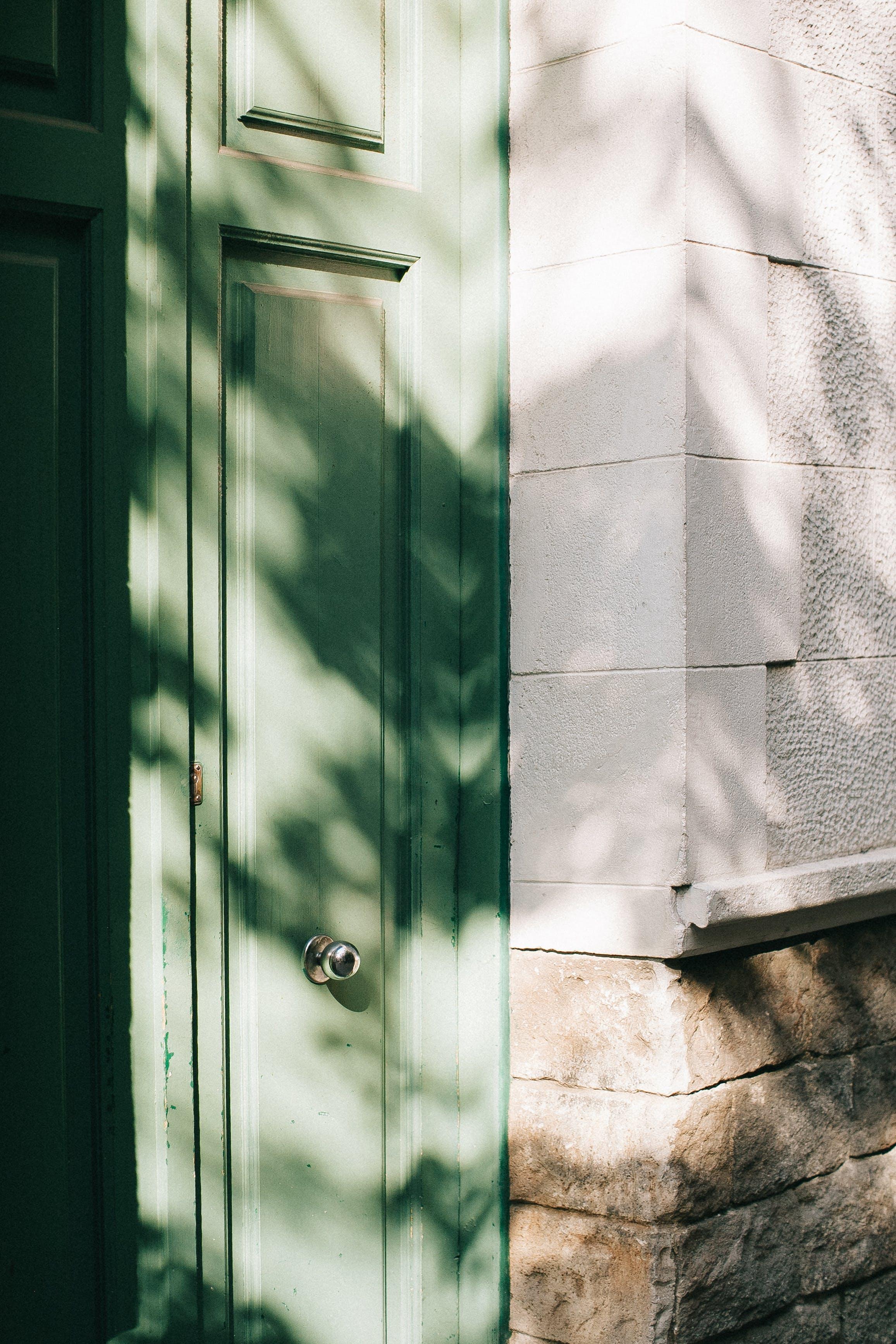 Teal Wooden Door With Gray Doorknob