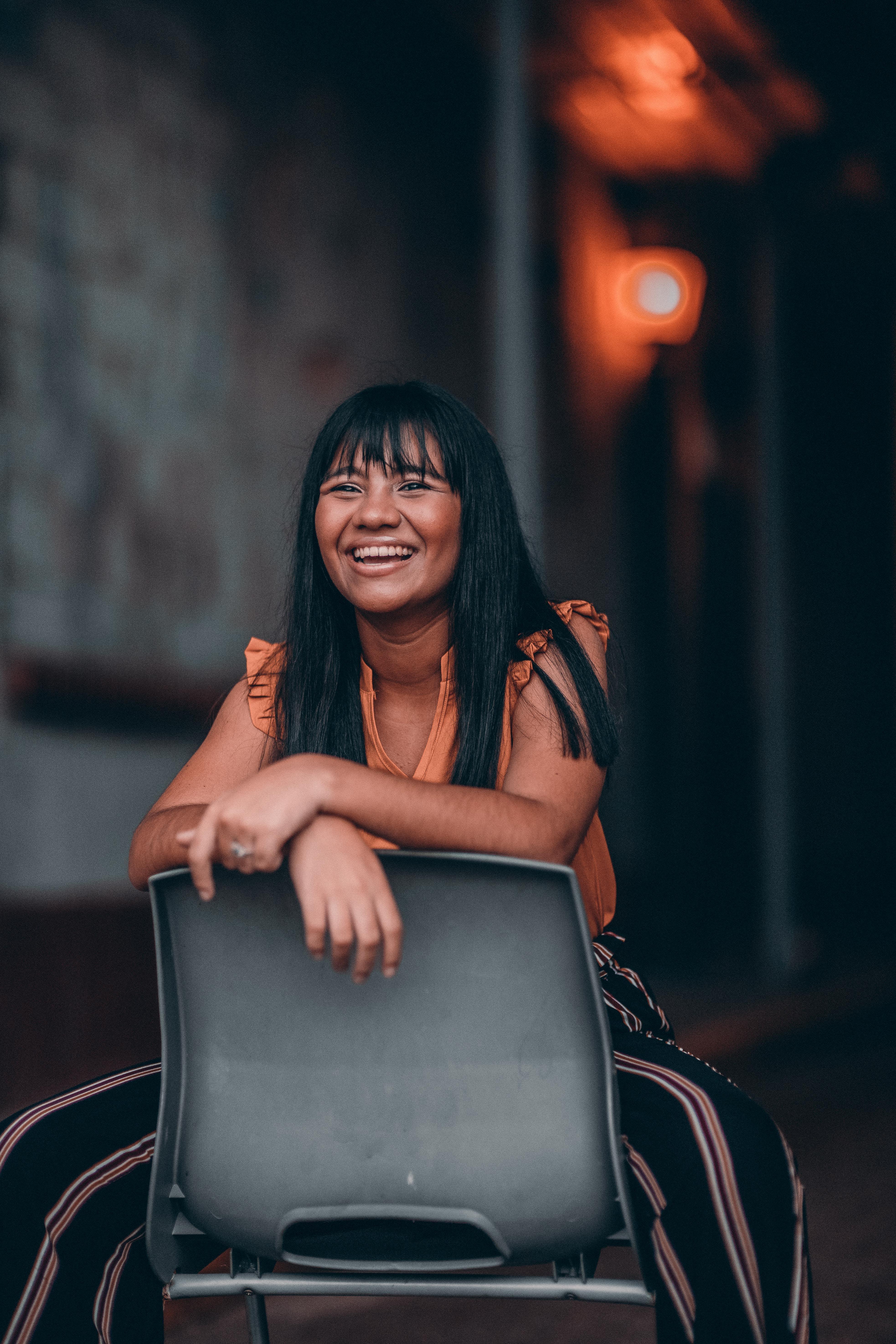 Woman Sitting on Gray Plastic Chair