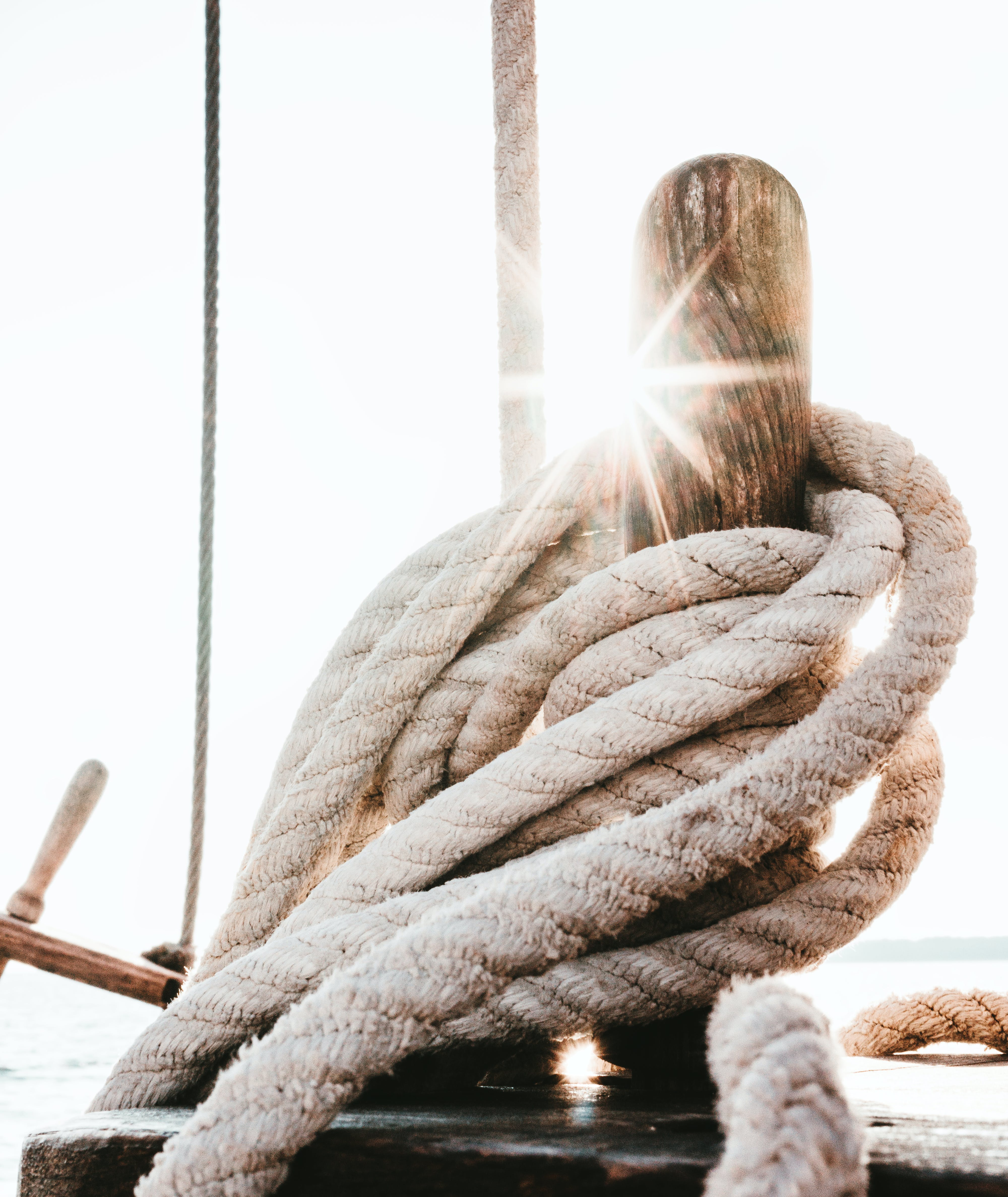Brown Wooden Stick Surrounded by Rope