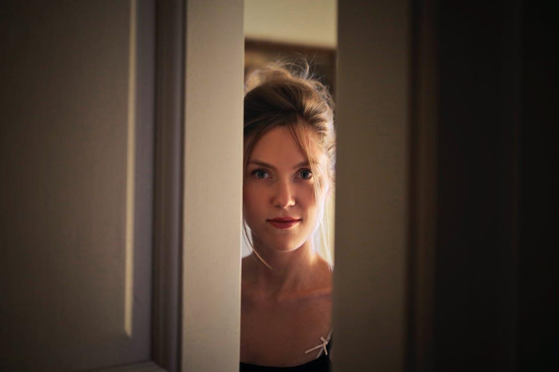 Woman Near Door Inside the Room