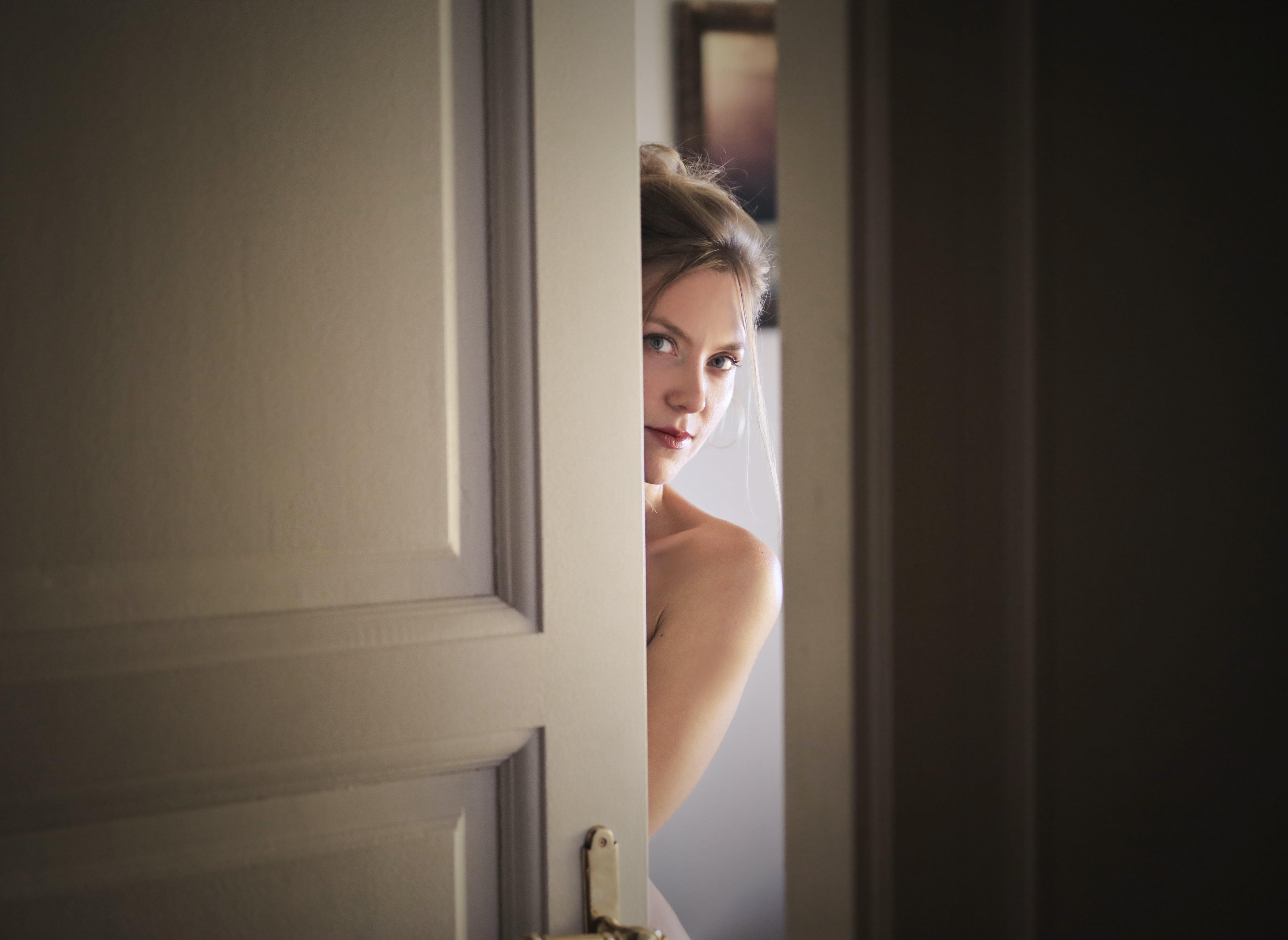 Photo of Woman Behind Door