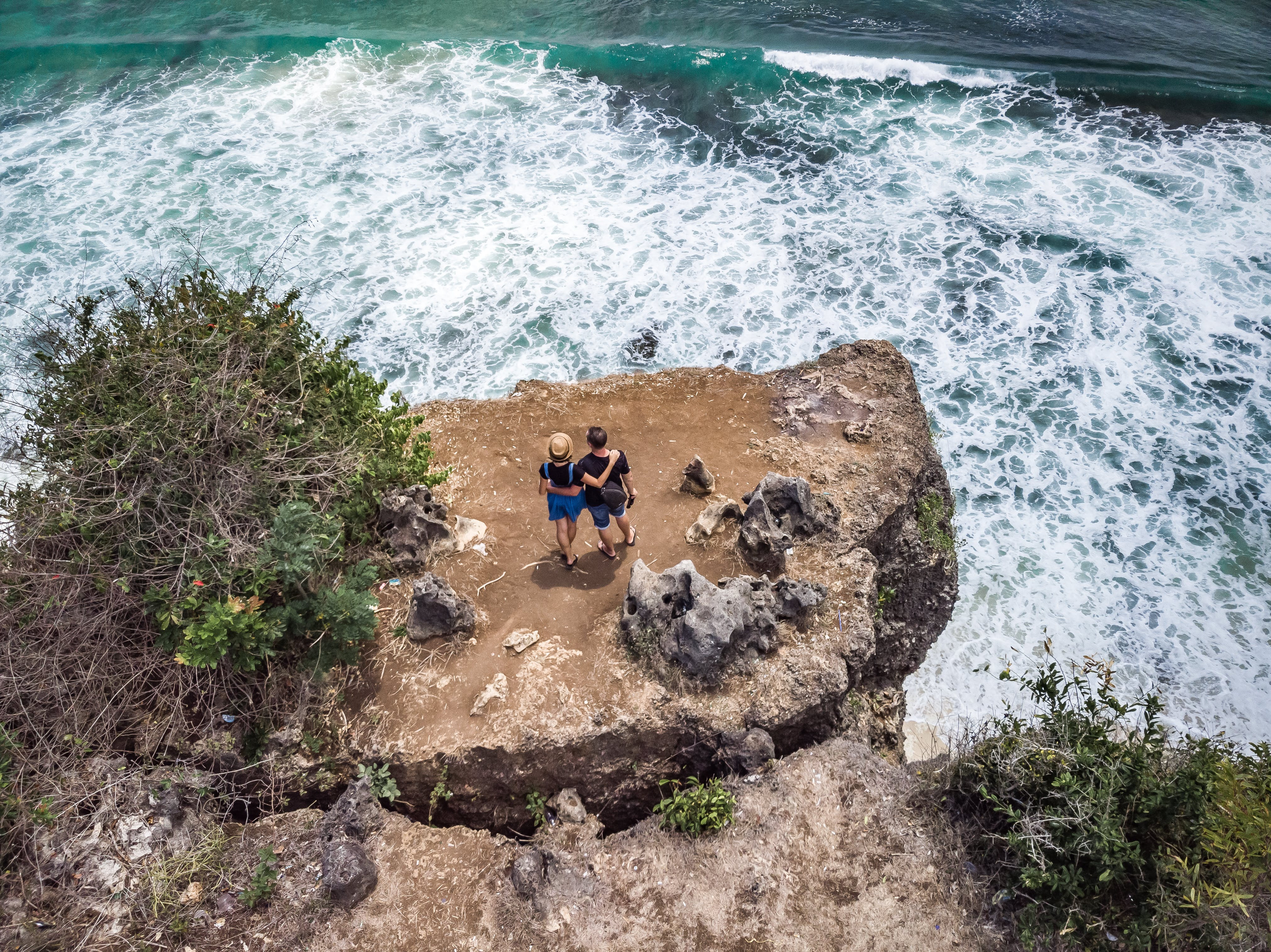 Photography of People Standing Near Cliff