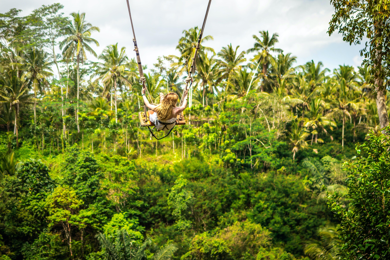 Woman Riding Giant Swing