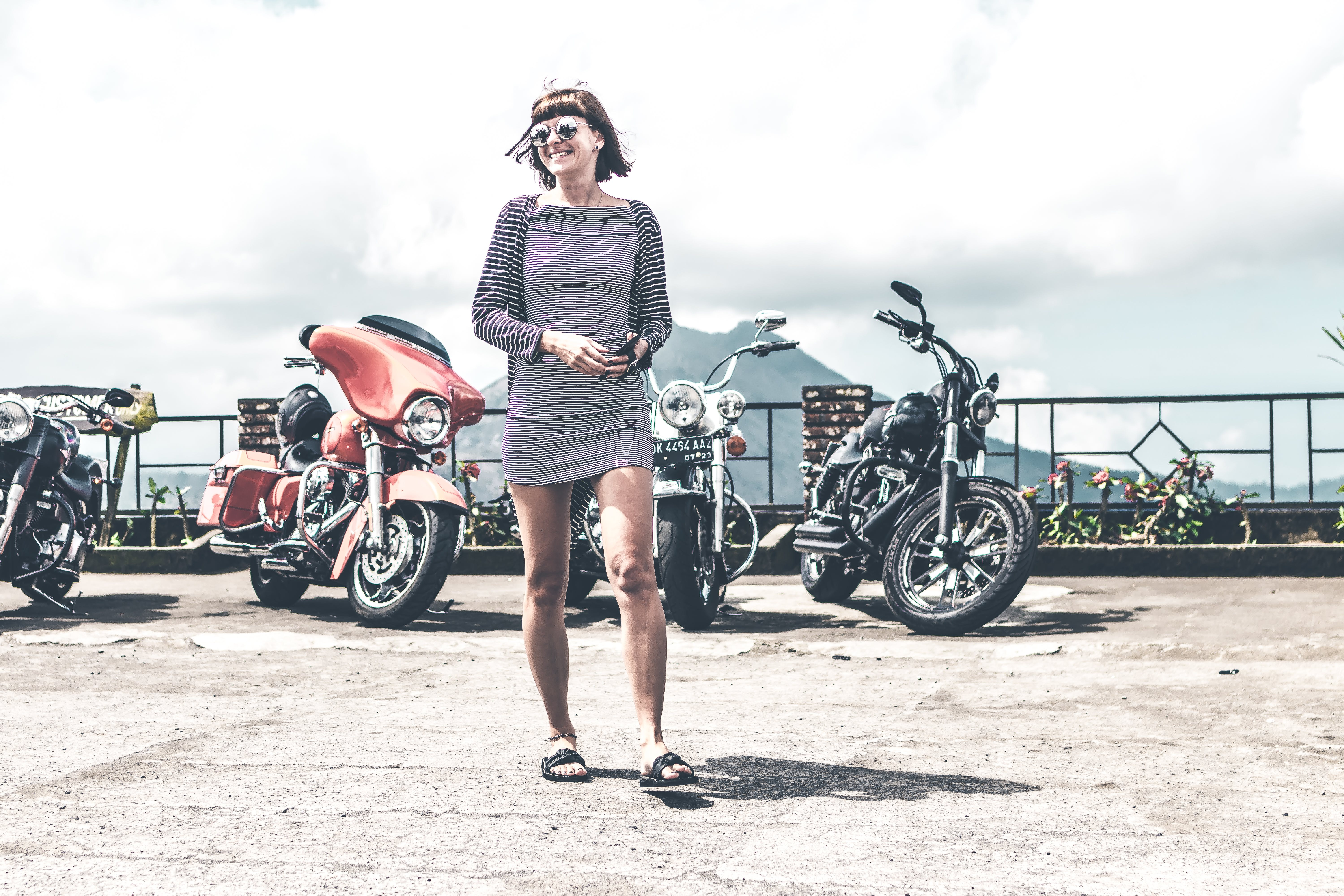 Photo of Woman Near Parked Motorcycles