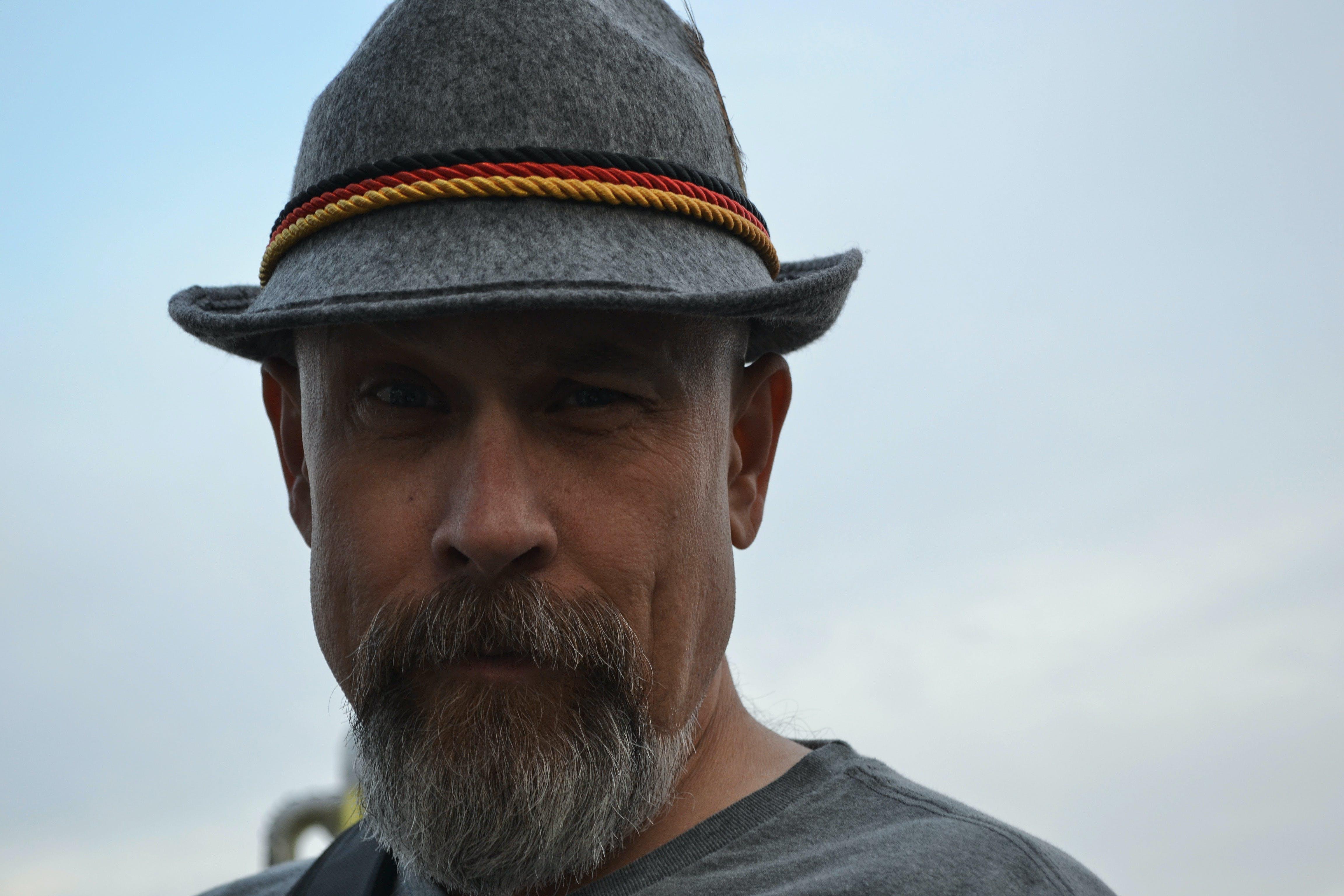 Man Wearing Hat Taking Selfie