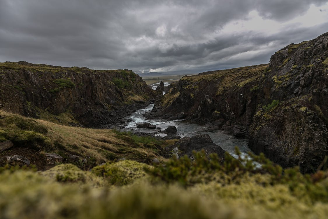 Aerial Photography of River Between Cliffs