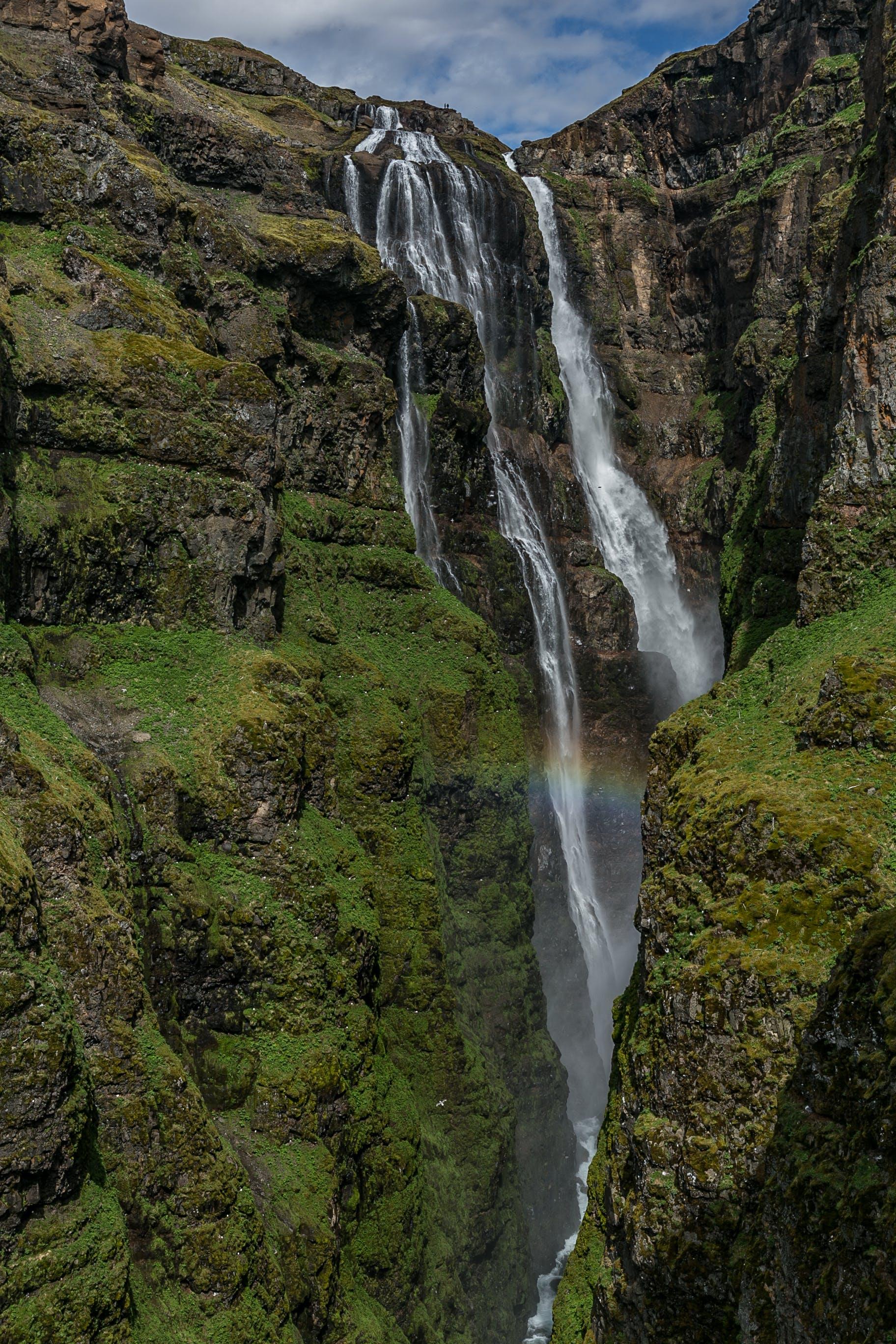Waterfalls Under White Clouds