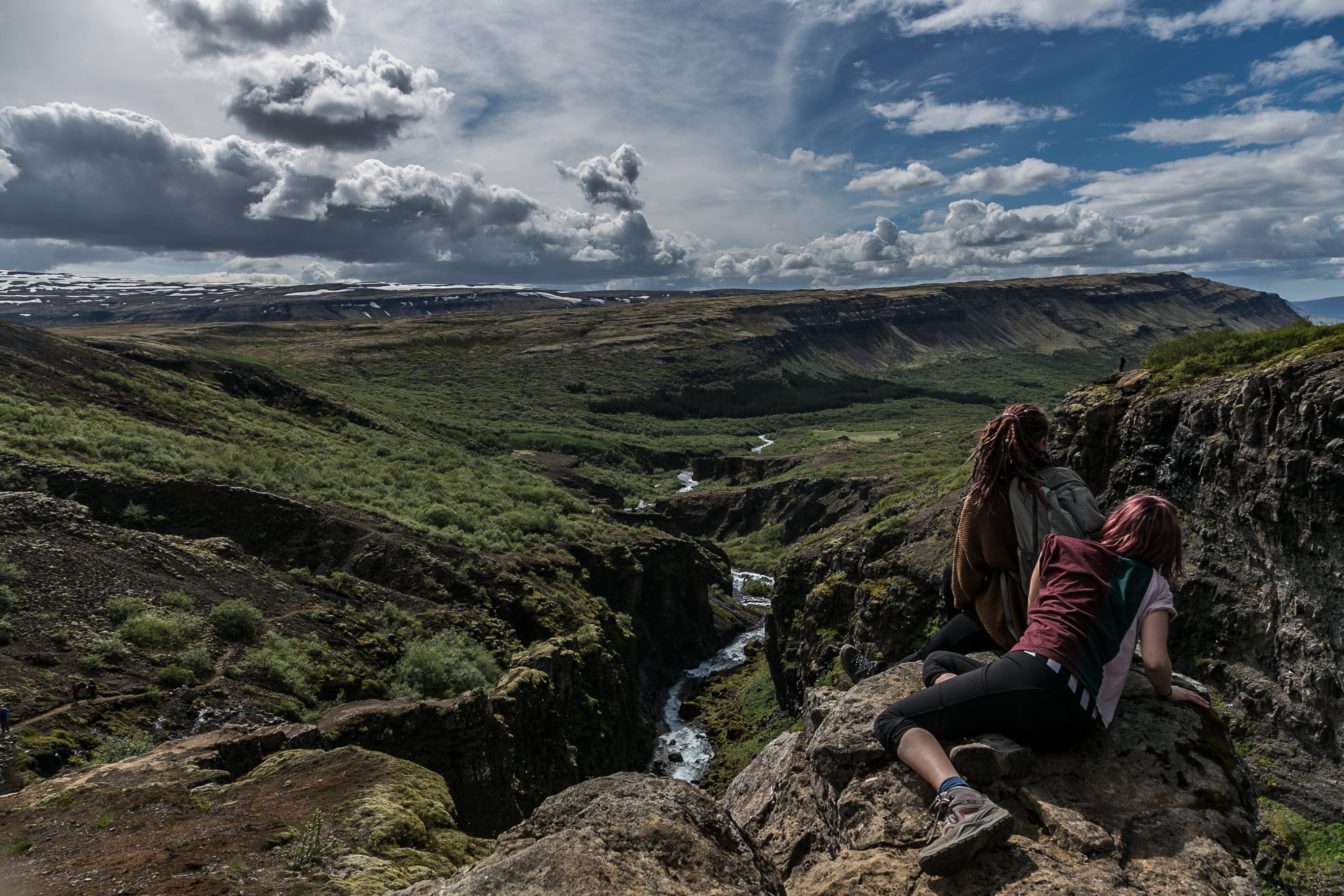 Landscape Photography of Woman Lying on Rock Mountain