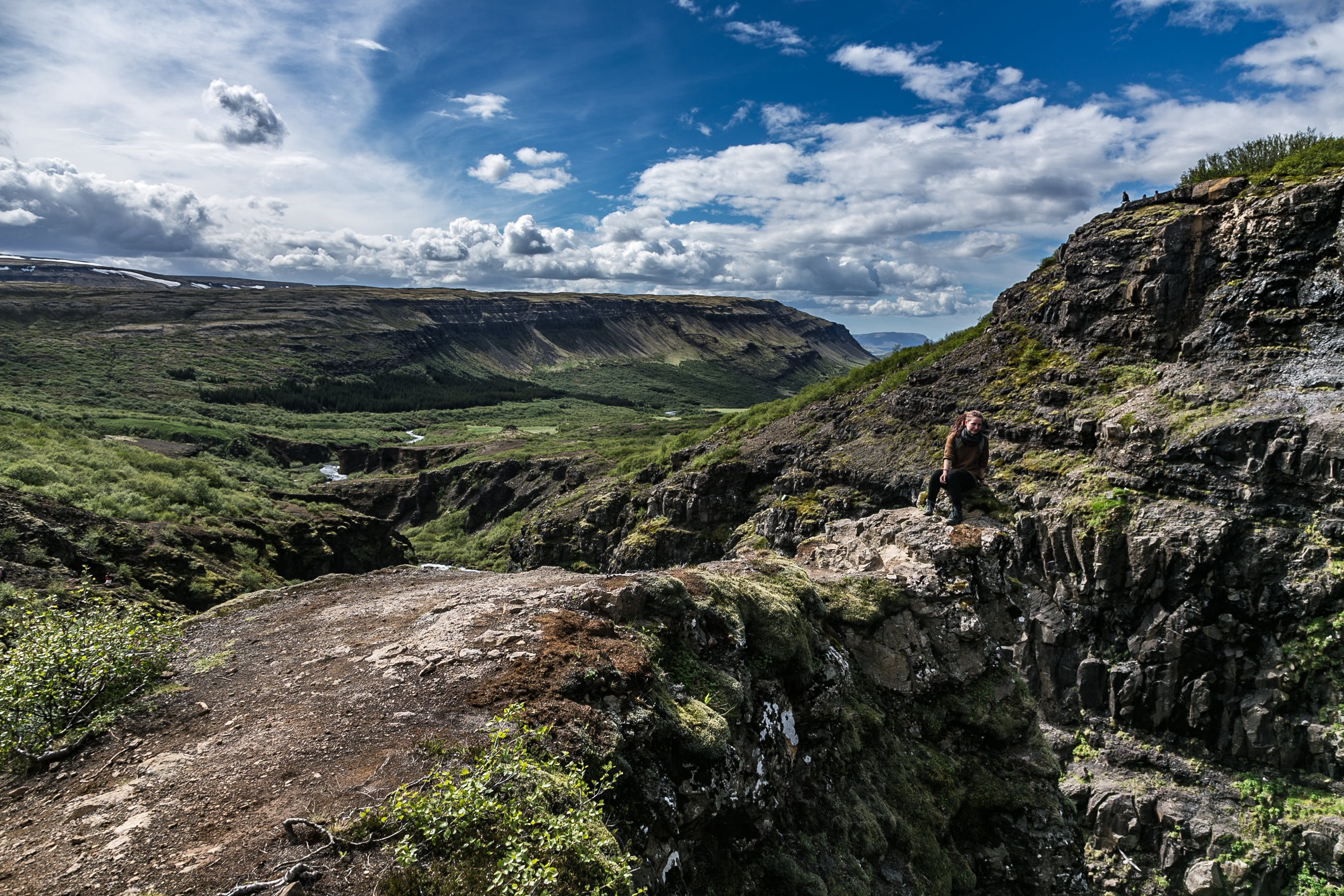 Person Near Mountain Cliff